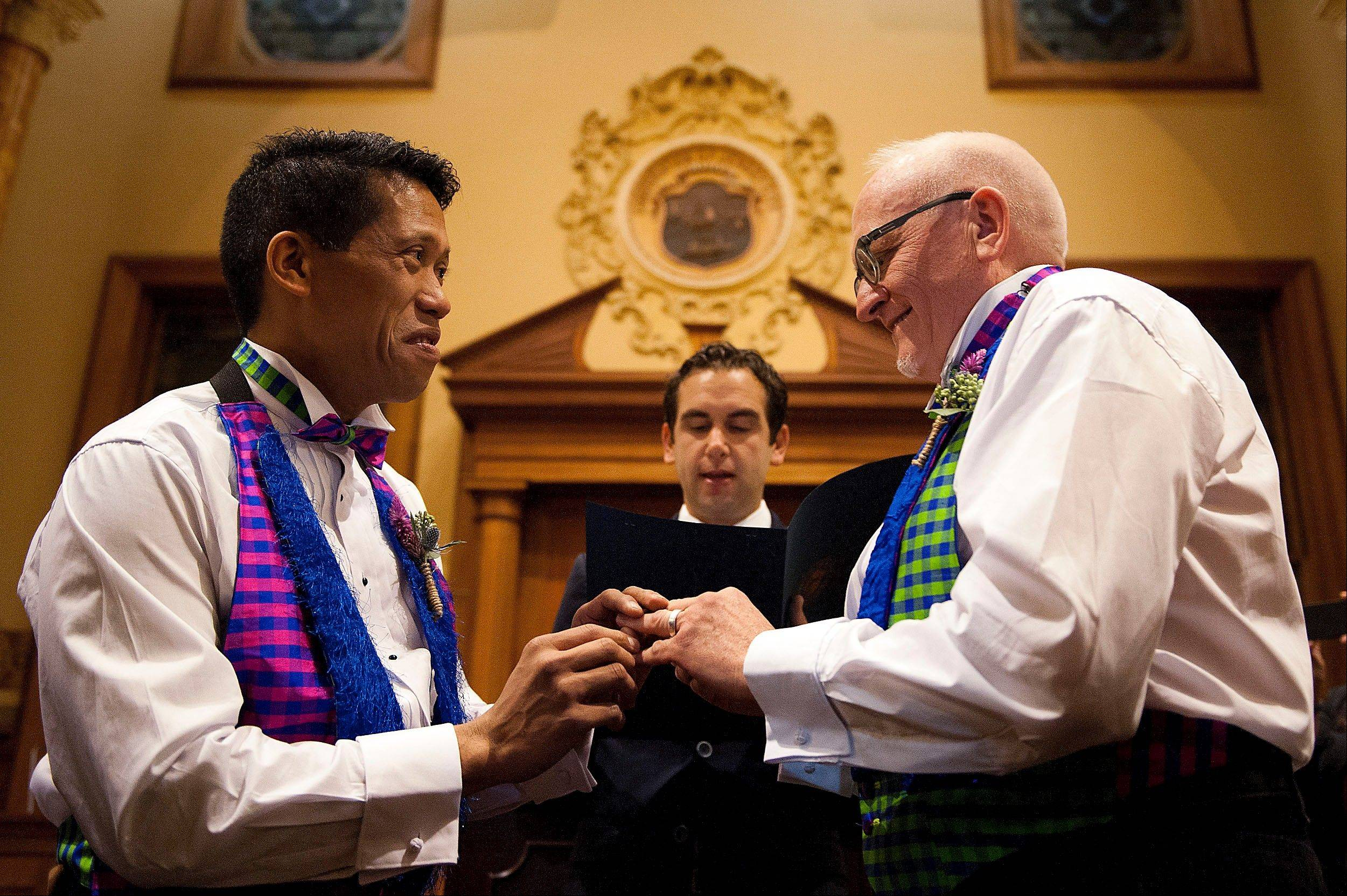 David Gibson, right, and Richard Kiamco of Jersey City make history as they become the first official same-sex couple to be married in Jersey City in a ceremony officiated by Mayor Steve Fulop at 12:01 a.m. Monday at City Hall. Seven other gay couples also participated in the ceremony.