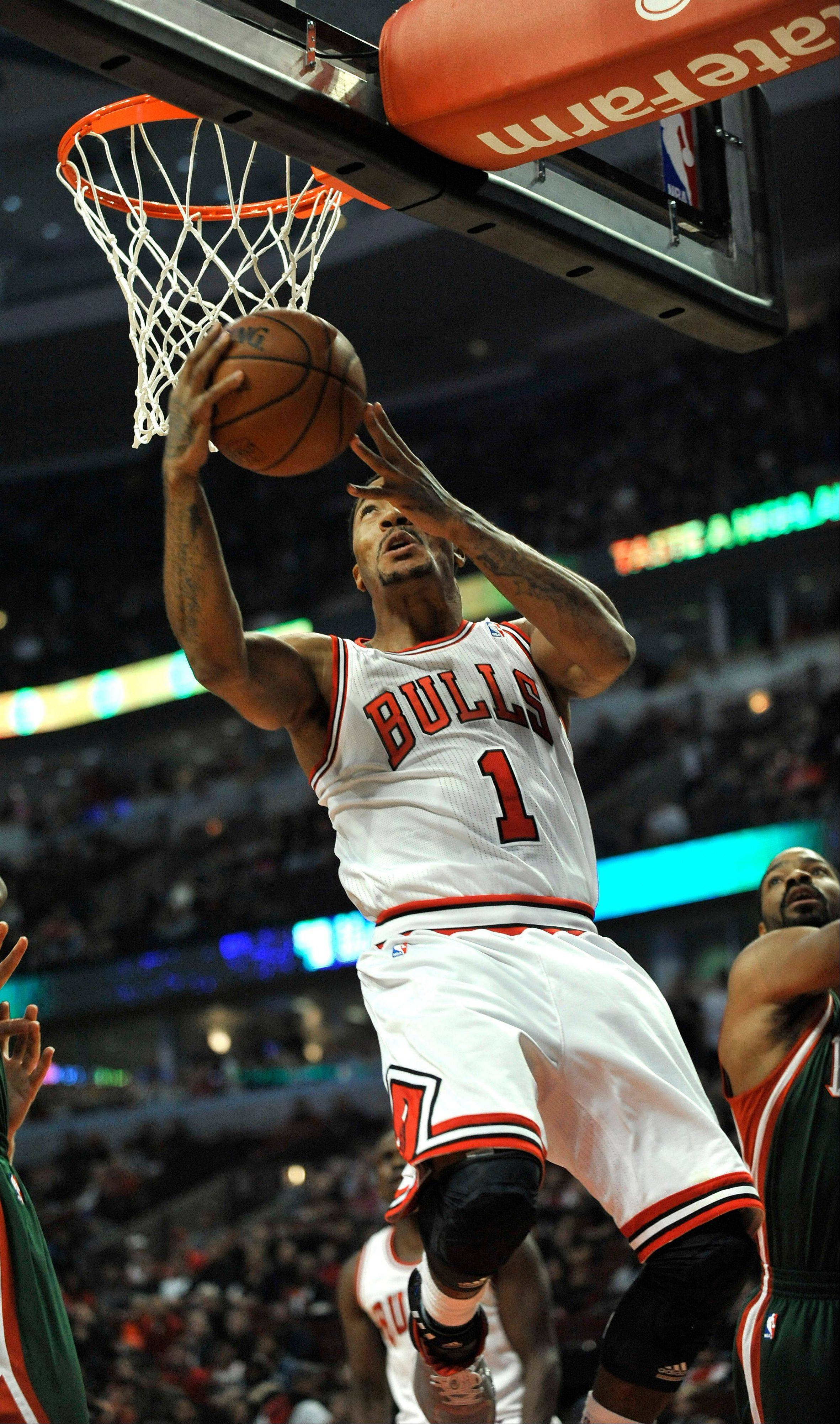 The Bulls' Derrick Rose goes up for a shot during Monday night's preseason victory over the Bucks at the United Center. Rose finished with 24 points as the Bulls improved to 6-0.