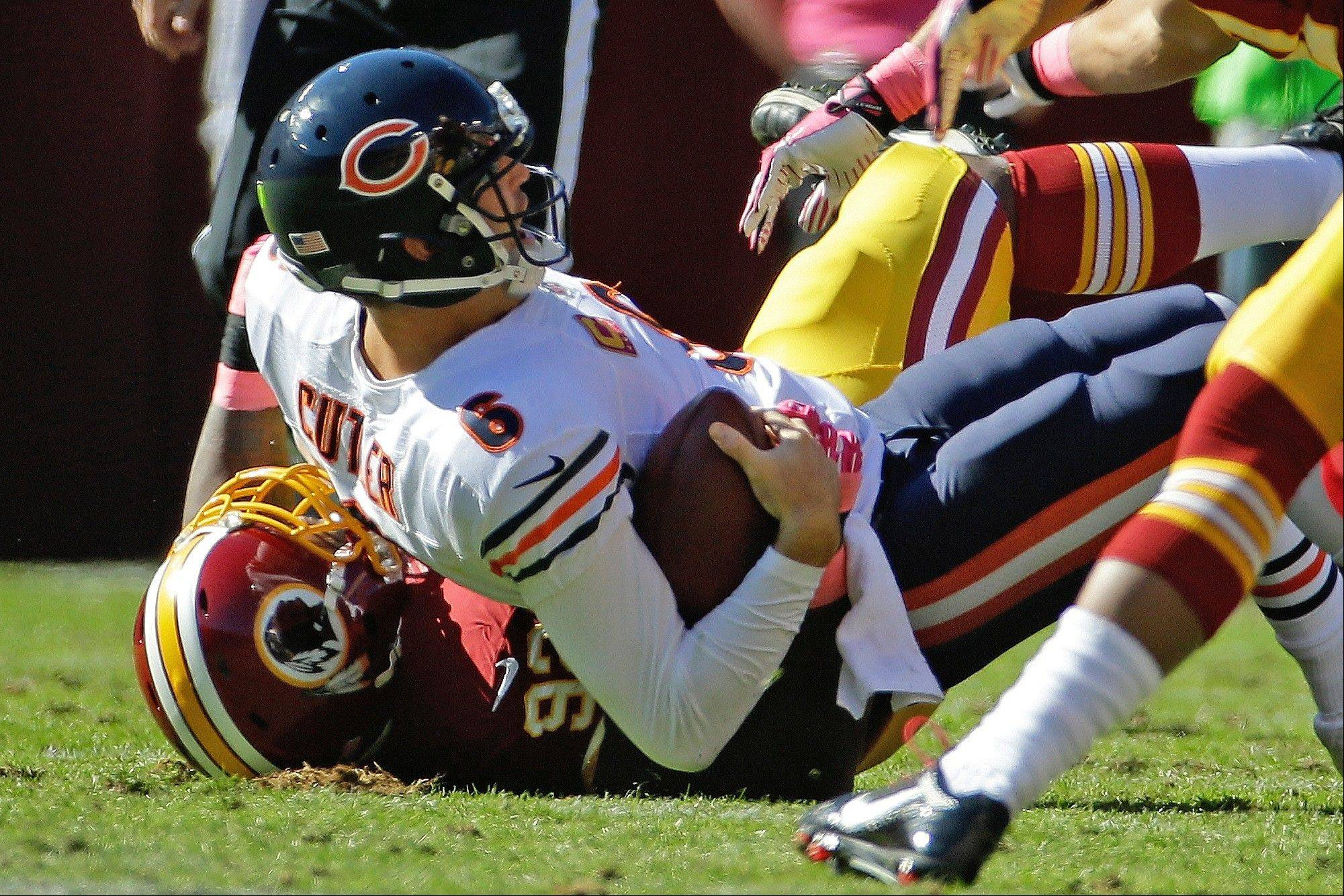 Bears quarterback Jay Cutler is sacked by Washington defensive end Chris Baker during Sunday's loss. Cutler suffered a groin injury on the play.