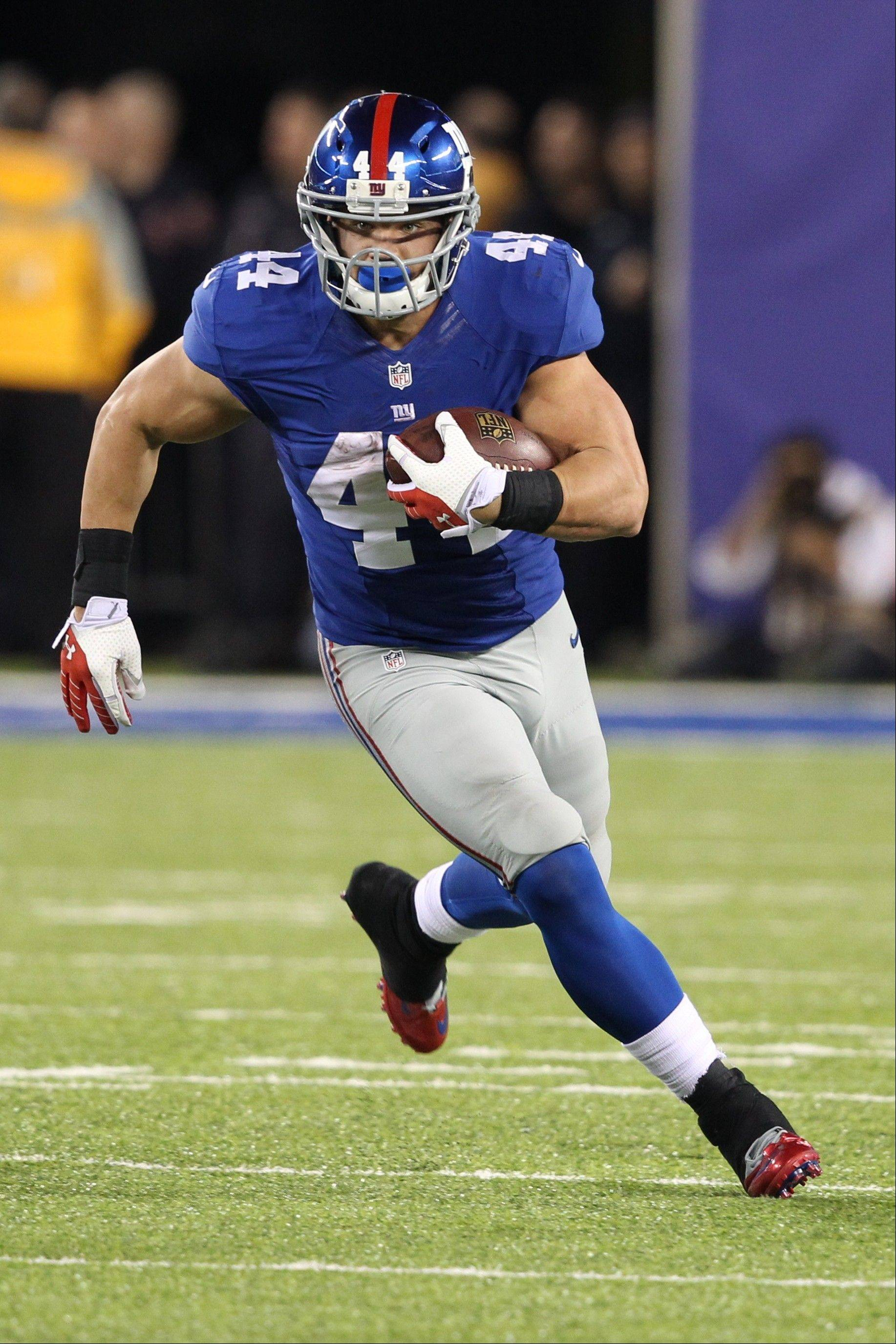 Newly acquired running back Peyton Hillis rushed for 36 yards and a touchdown in the Giants' 23-7 win over the Vikings on Monday night in East Rutherford, N.J.