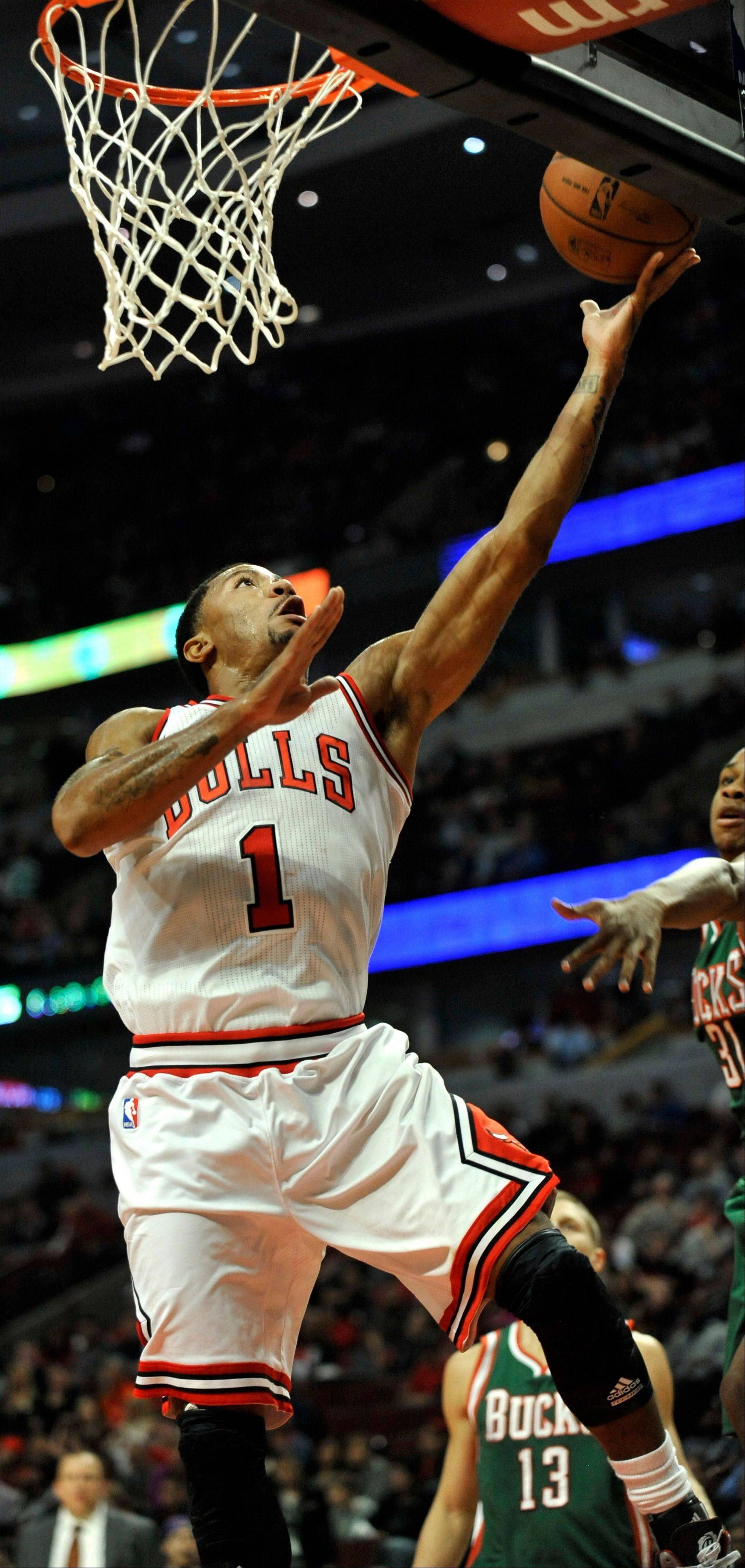 The Bulls' Derrick Rose goes up for a shot against the Milwaukee Bucks during the first half of a preseason game Monday in Chicago.