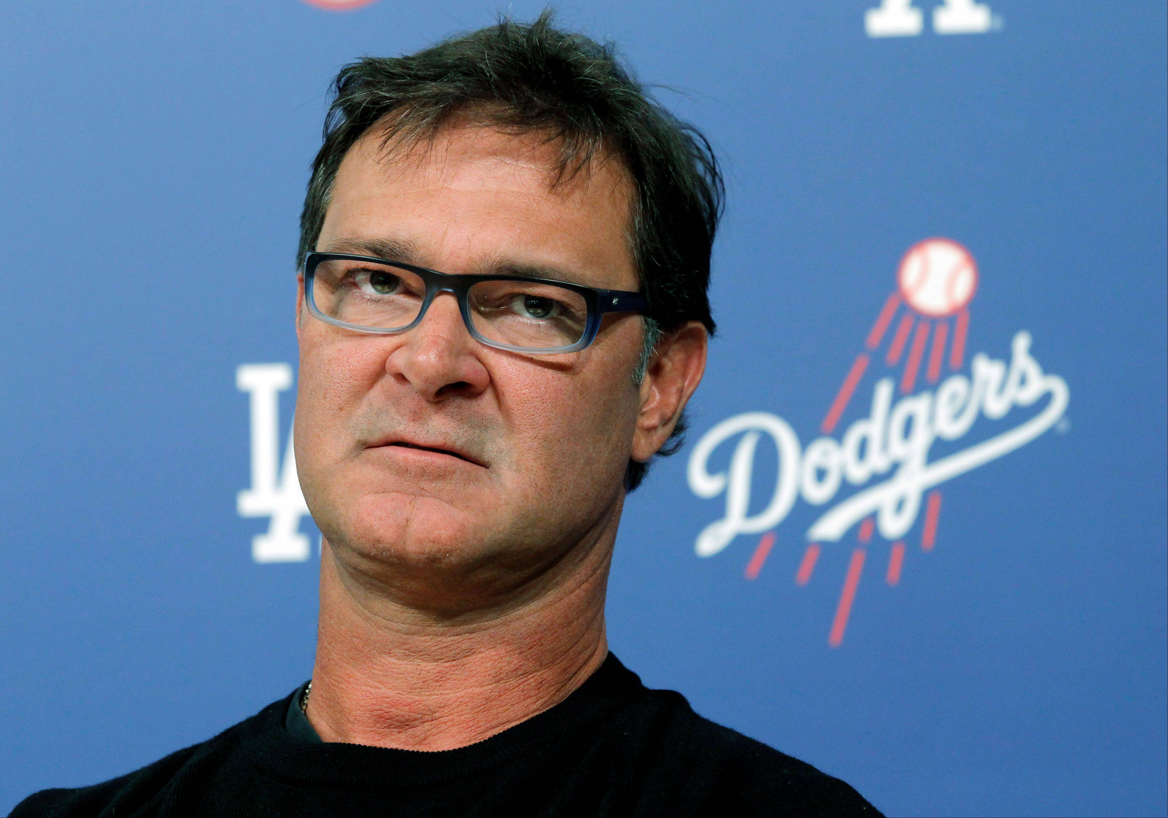 Dodgers Manager Don Mattingly speaks to the media Monday in Los Angeles. Mattingly is 260-225 in three years as manager.