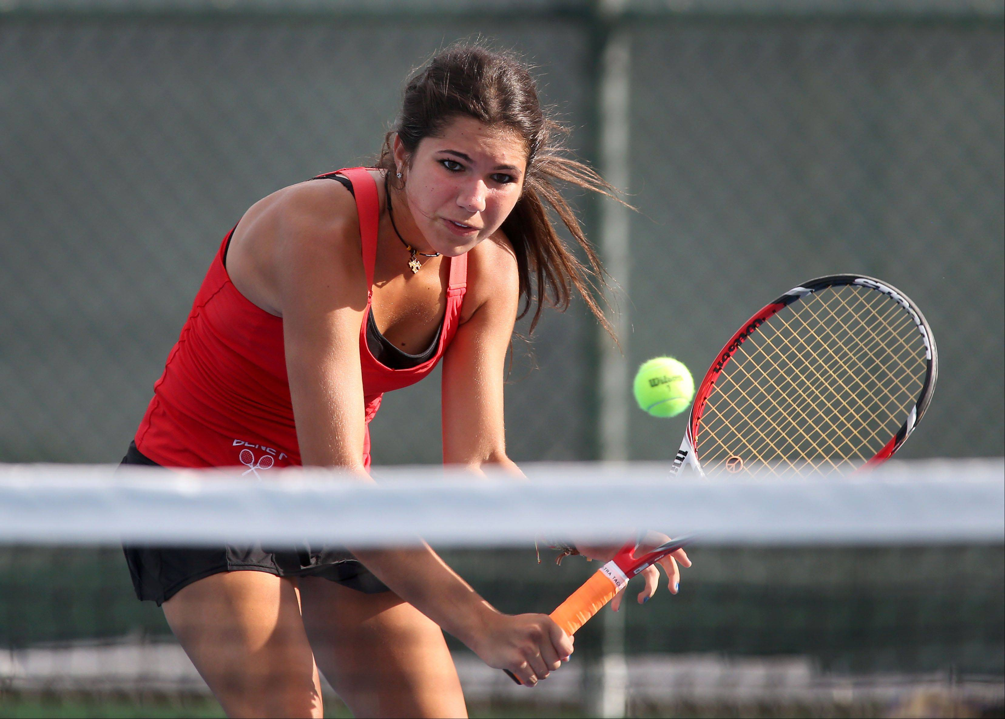 Leah Tzakis of Benet moves up for a volley in tennis action against Naperville Central on Tuesday in Naperville.