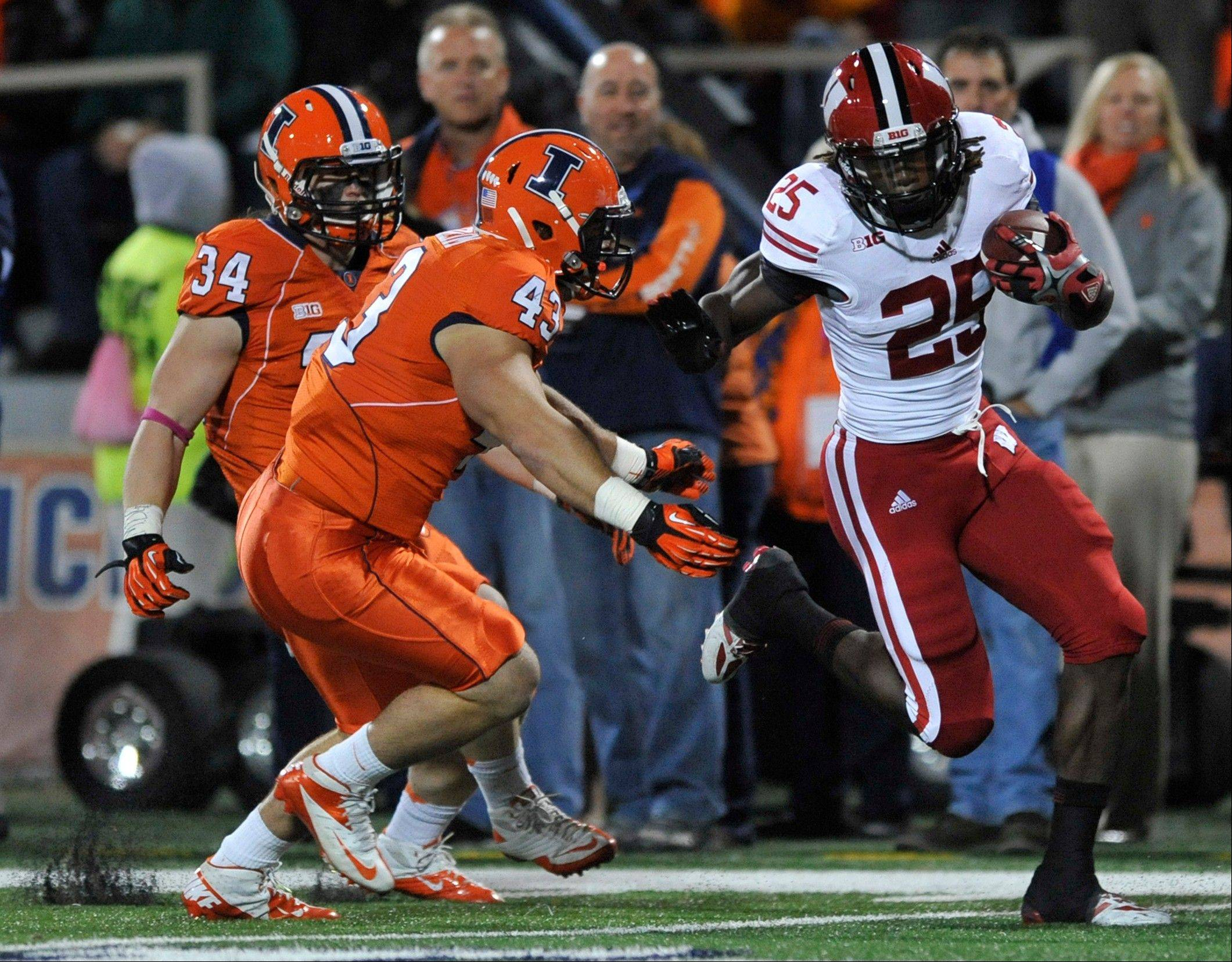 Wisconsin running back Melvin Gordon rushes against Mason Monheim (43), and Mike Svetina (34) during the first quarter of Illinois' 56-32 home loss on Saturday. The Illini gave up 289 rushing yards in the game.