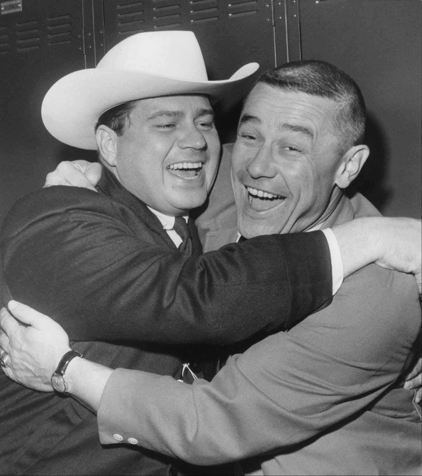"Coach Wally Lemm of the Houston Oilers, right, gets a big hug in the dressing room from K.S. ""Bud"" Adams Jr., team president, after Houston beat San Diego 10-3 to win the American Football League championship in 1961."