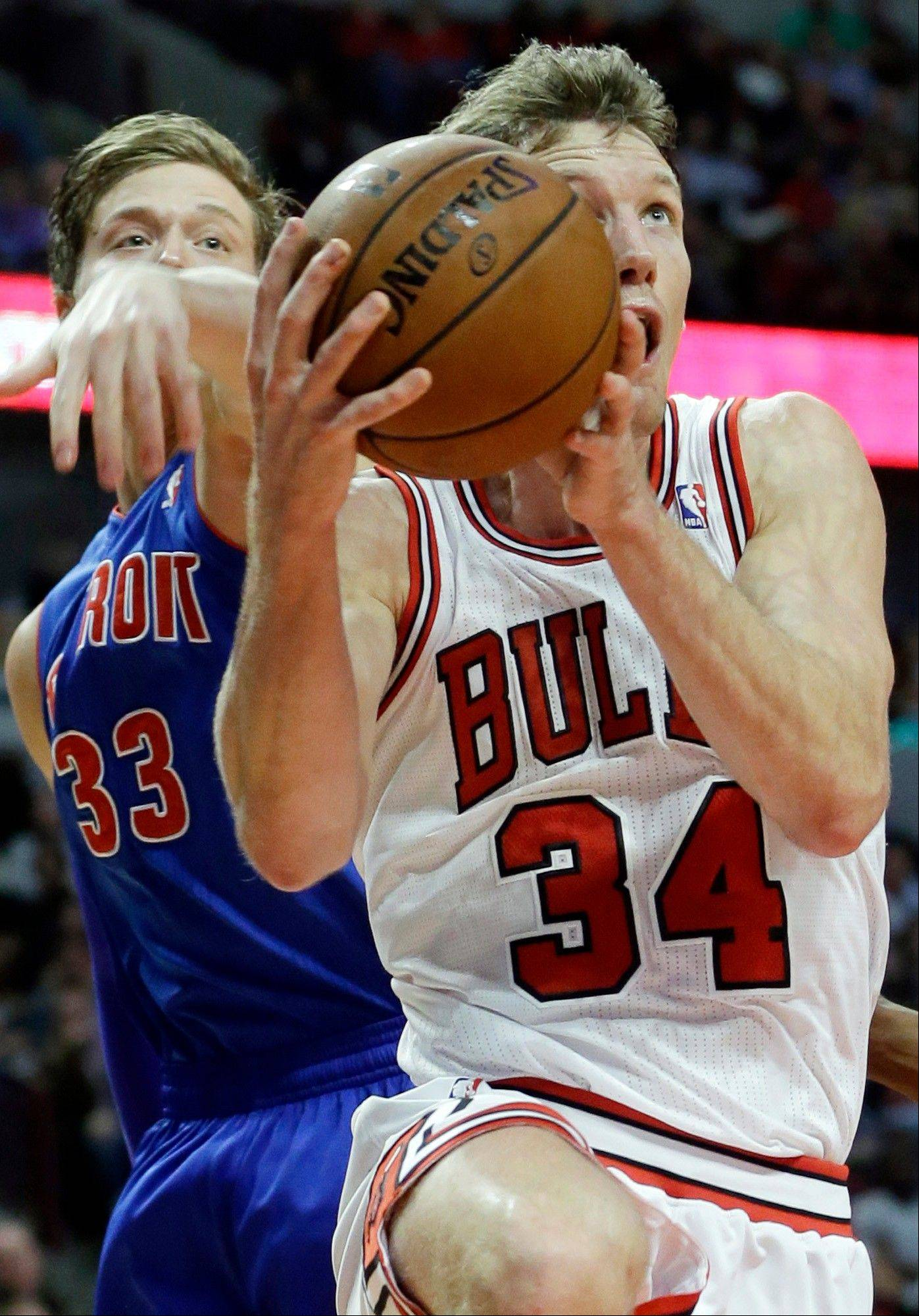 "Bulls forward Mike Dunleavy drives to the basket past Detroit's Jonas Jerebko last Wednesday. Dunleavy, in his first season with the Bulls, says, ""We're here to get better every day."""