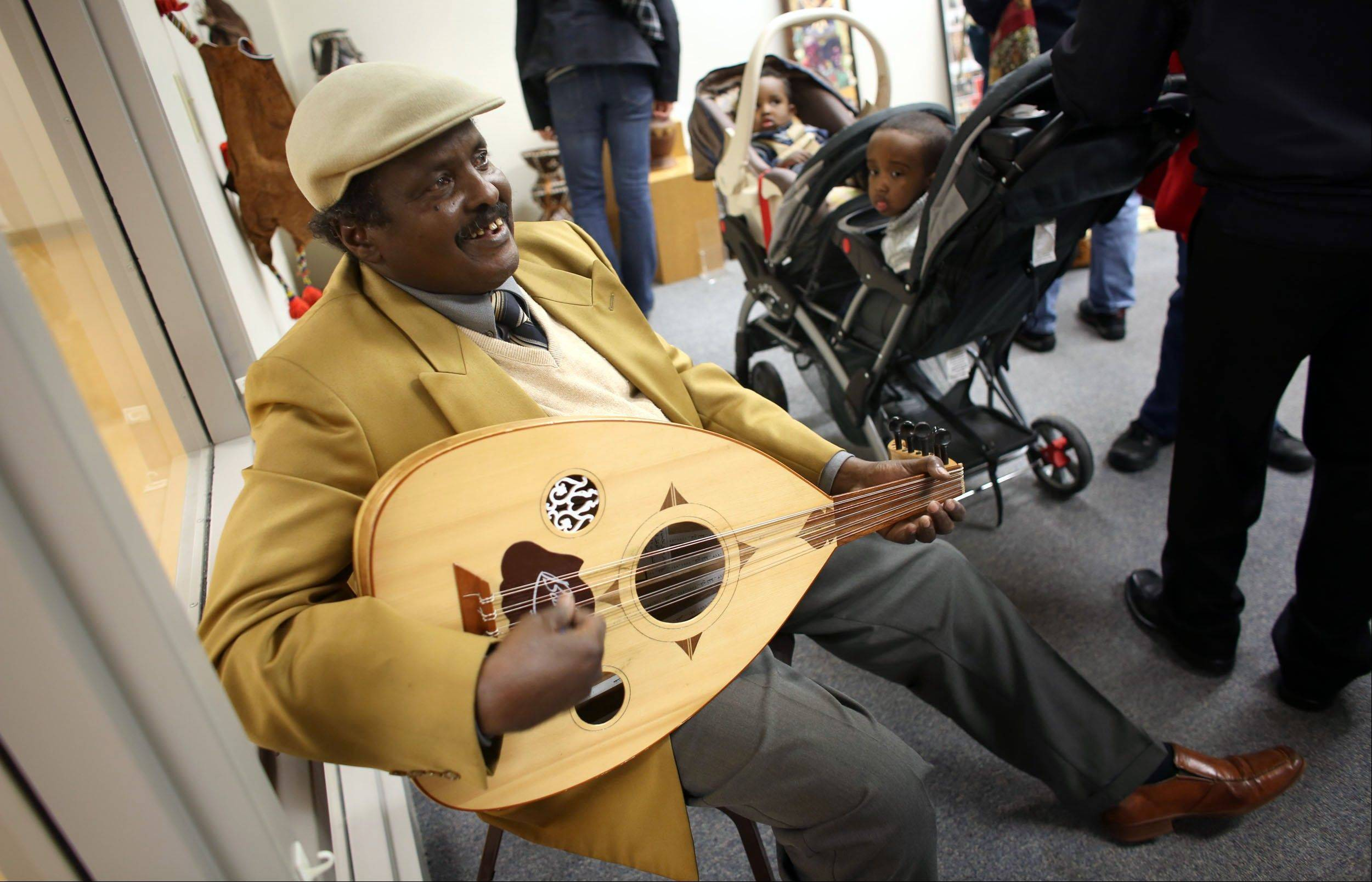 Abdulkadir Said played traditonal Somali music as visitors walked in during the grand opening of the Somali Artifact and Cultural Museum in Minneapolis Saturday.