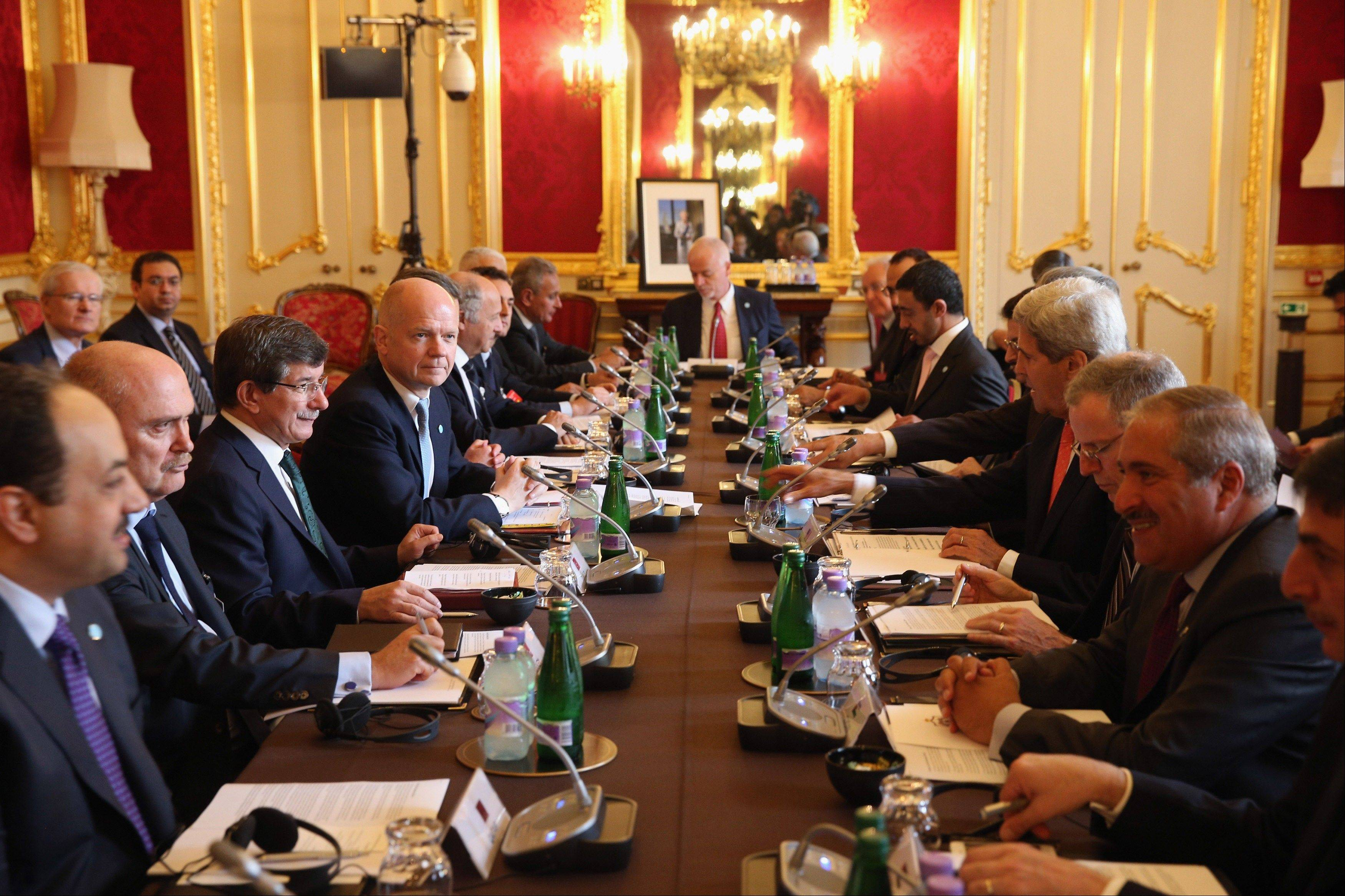 Secretary of State John Kerry, fourth from right, attends a meeting Tuesday, hosted by British Foreign Secretary William Hague, fourth from left, in London, aimed at ending the civil war in Syria.