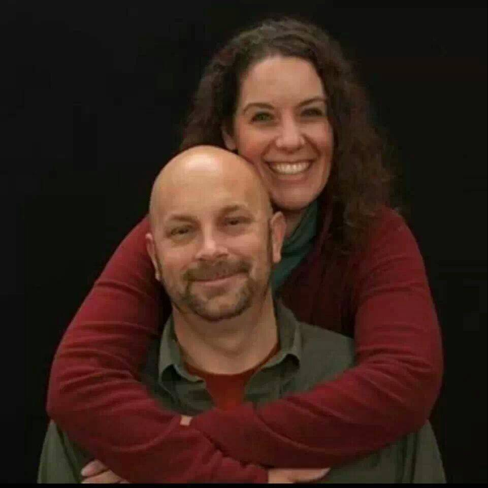 This undated photo provided by Chandra Landsberry shows Sharon and Michael Landsberry. Police lauded the actions of Landsberry, a 45-year-old math teacher and former Marine, who they say tried to stop the rampage before he was fatally shot in the chest.