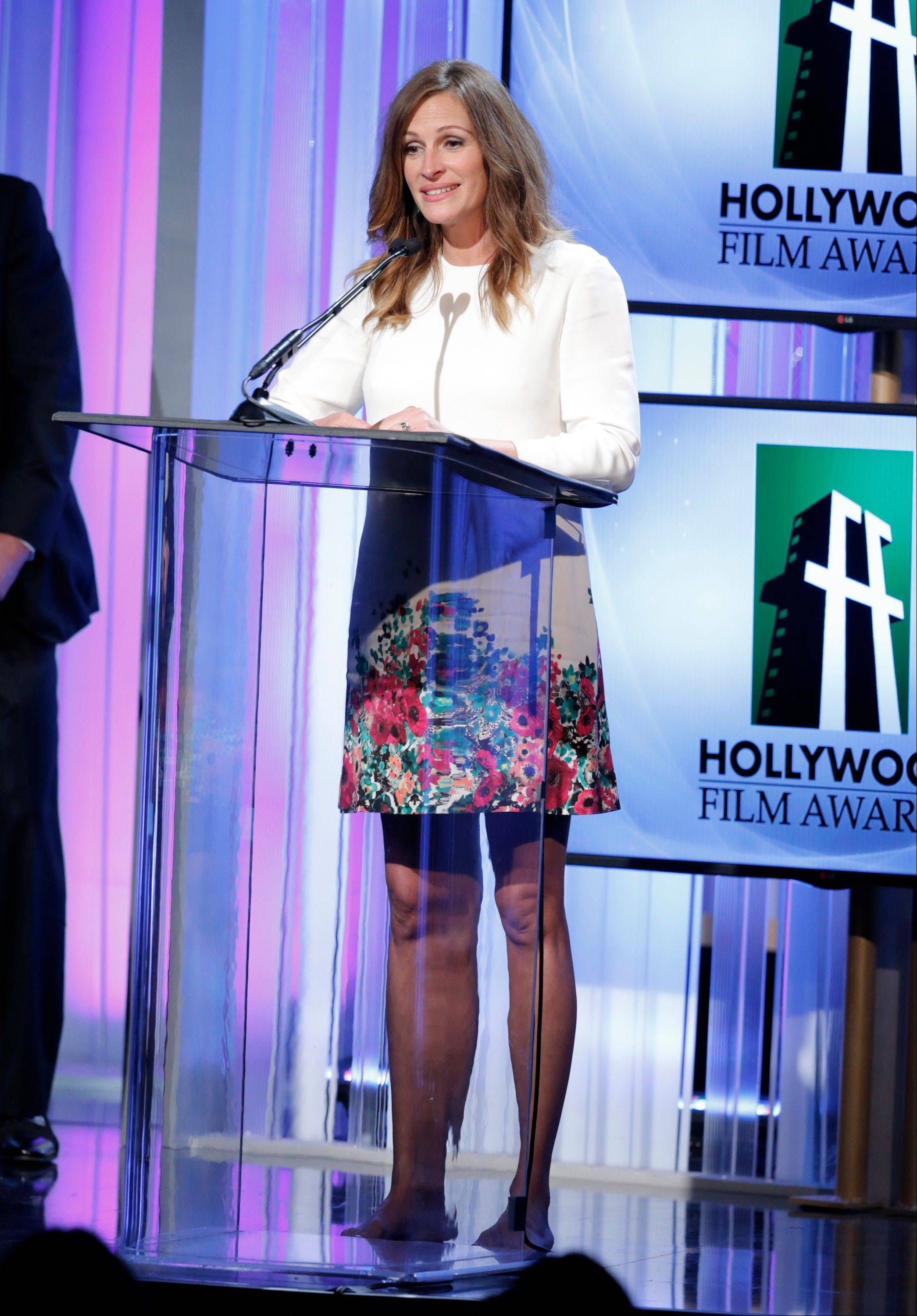 Julia Roberts accepts the Hollywood Supporting Actress award at the 17th Annual Hollywood Film Awards Gala at the Beverly Hilton Hotel on Monday.