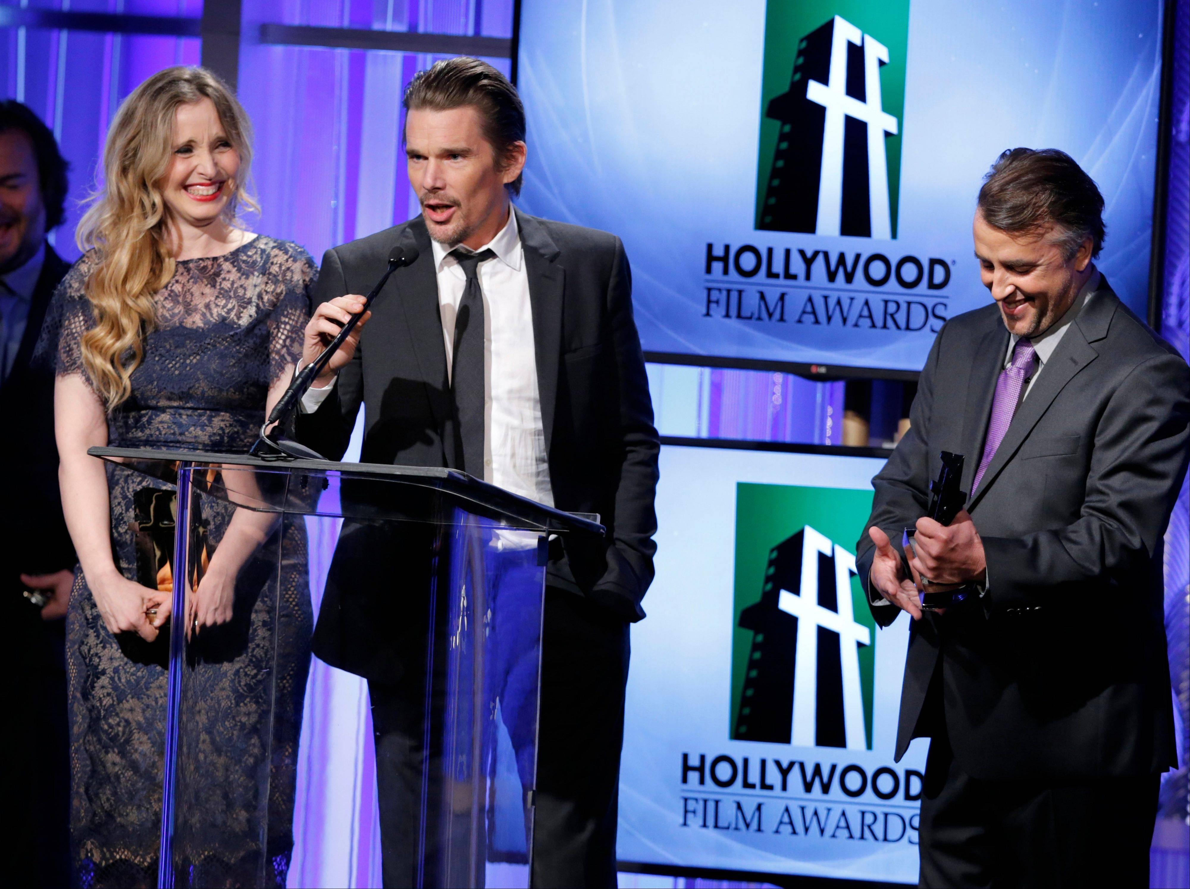 Julie Delpy, left, Ethan Hawke and Richard Linklater accept the Hollywood screenwriter award at the 17th Annual Hollywood Film Awards Gala Monday.