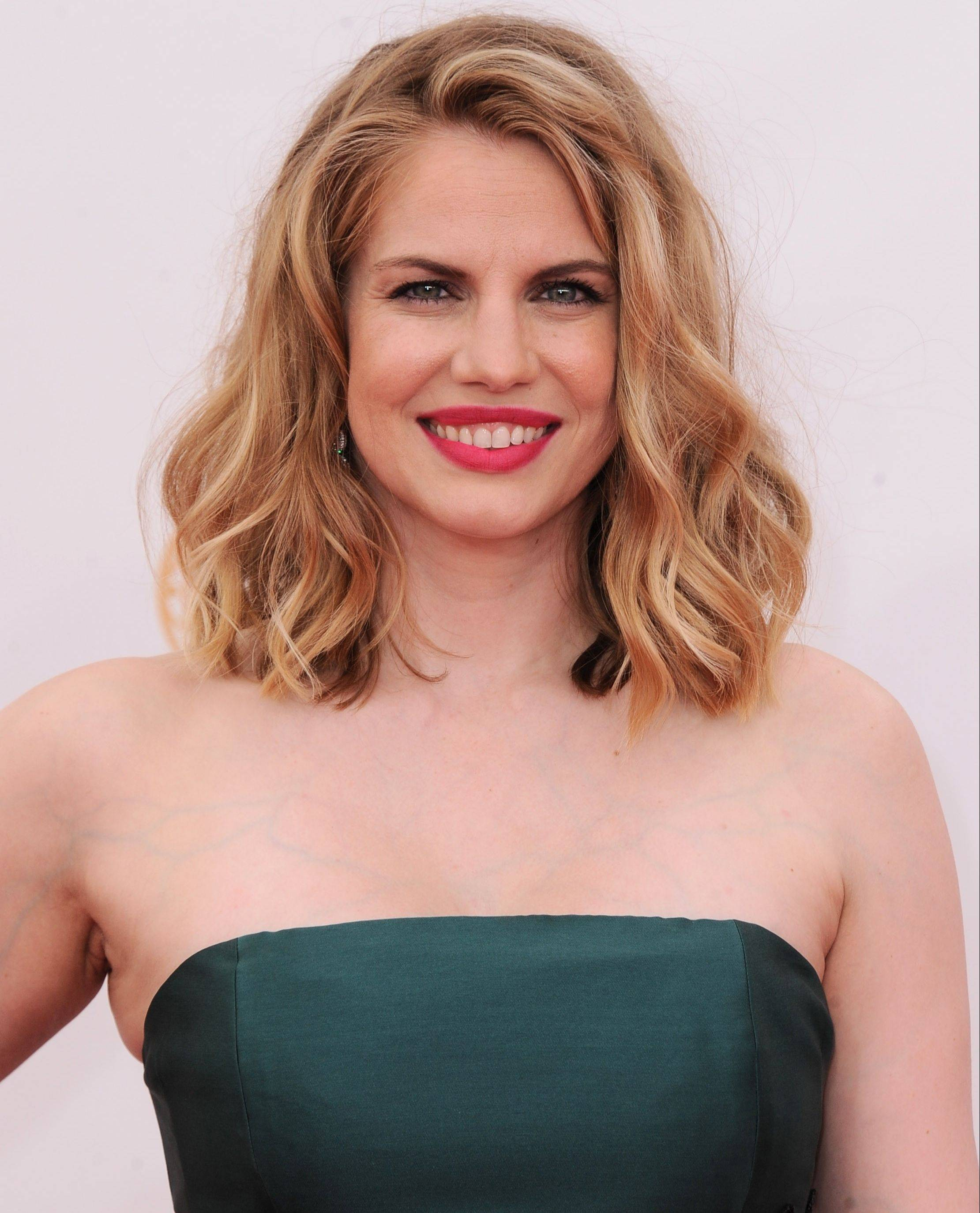 Outstanding Supporting Actress nominee Anna Chlumsky, of Broadview, arrives at the 65th Primetime Emmy Awards at the Nokia Theatre Sept. 22 in Los Angeles wearing a Badgley Mischka gown.