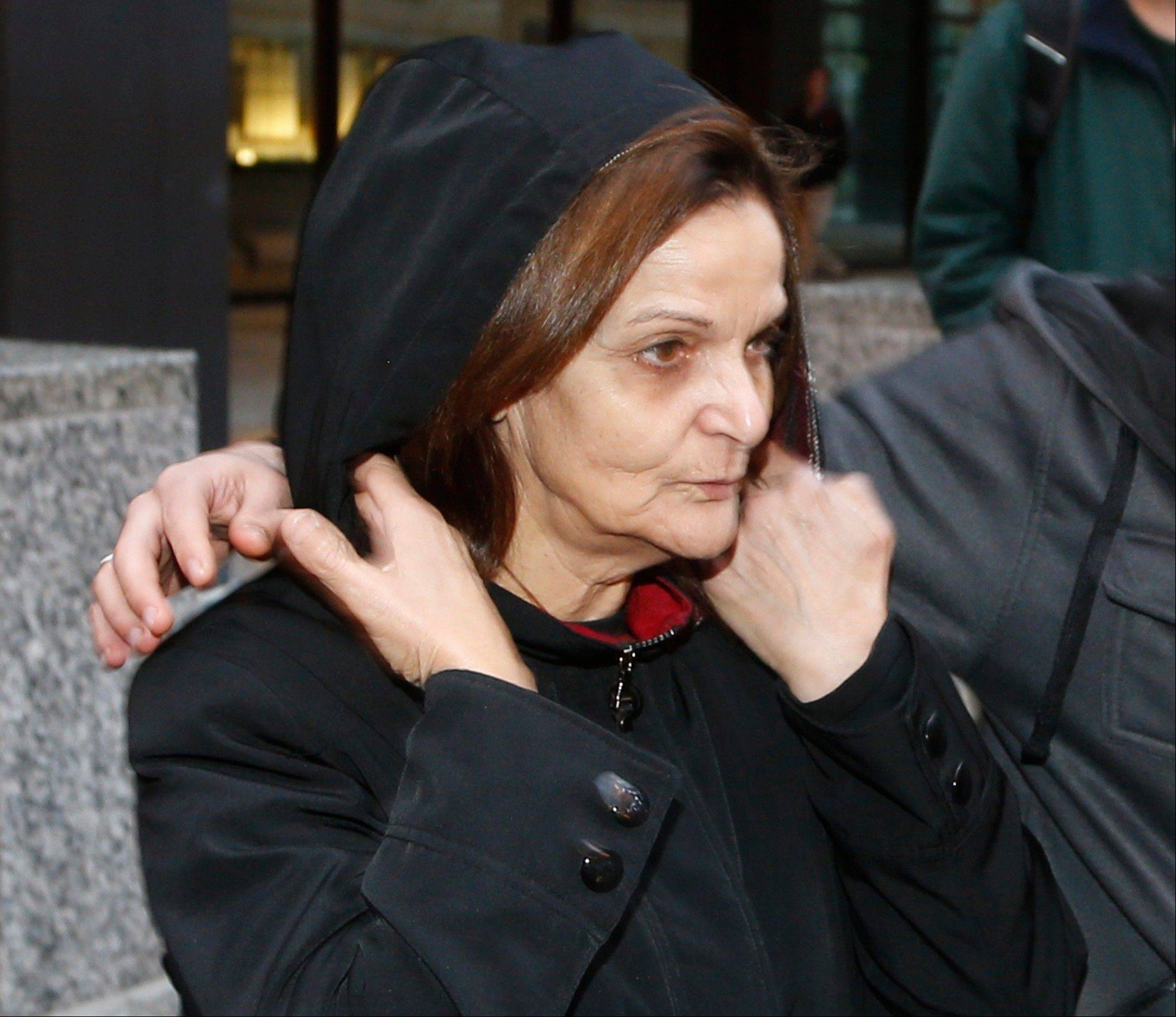 Rasmieh Yousef Odeh leaves the federal courthouse in Chicago after her initial appearance before U.S. Magistrate Judge Michael Mason. Odeh, 66, of Evergreen Park, was arrested Tuesday on charges she lied on immigration papers about her conviction for a deadly bombing more than 40 years ago in Israel.