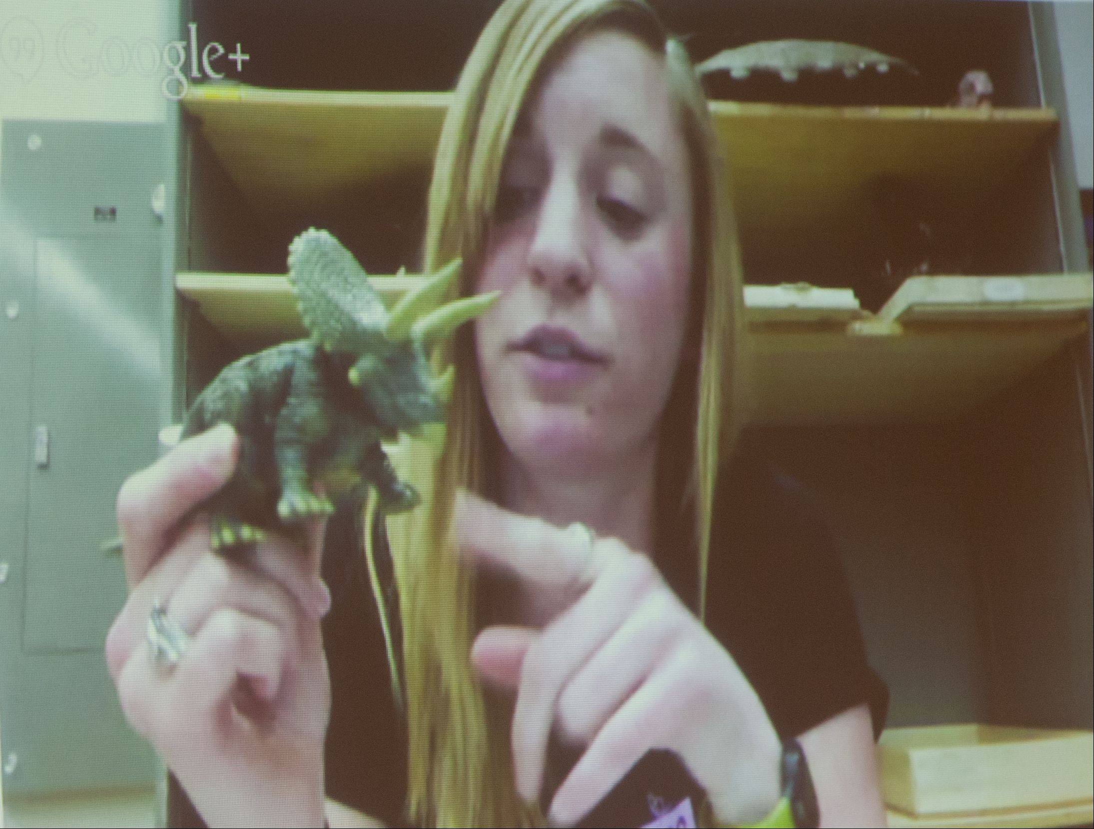"Betsy Kruk shares some of her knowledge about dinosaurs with students from Stratford Middle School in Bloomingdale via a video conference. ""I get to cut up dinosaur bones and see what I can understand,"" she told the kids."