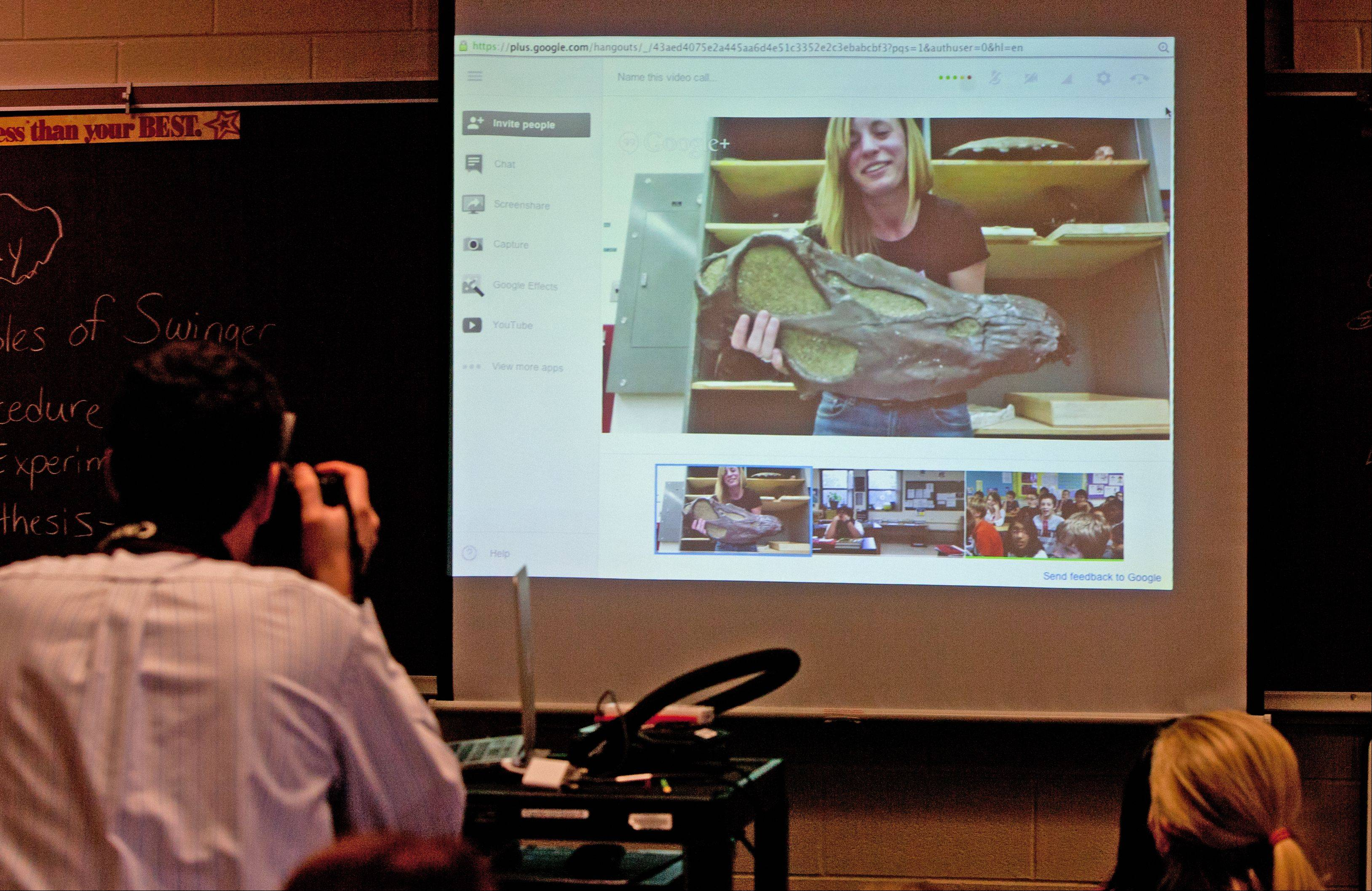 Students at Stratford Middle School in Bloomingdale learn about dinosaurs via a video conference Tuesday with former student and current paleontologist Betsy Kruk.