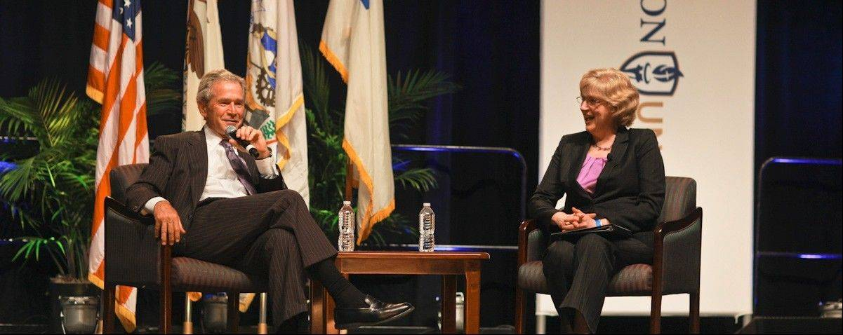 Former President George W. Bush, inaugural speaker for Judson University's World Leaders Forum, being interviewed in 2011 by Carol Thompson, a Judson alumna and board member at the time.