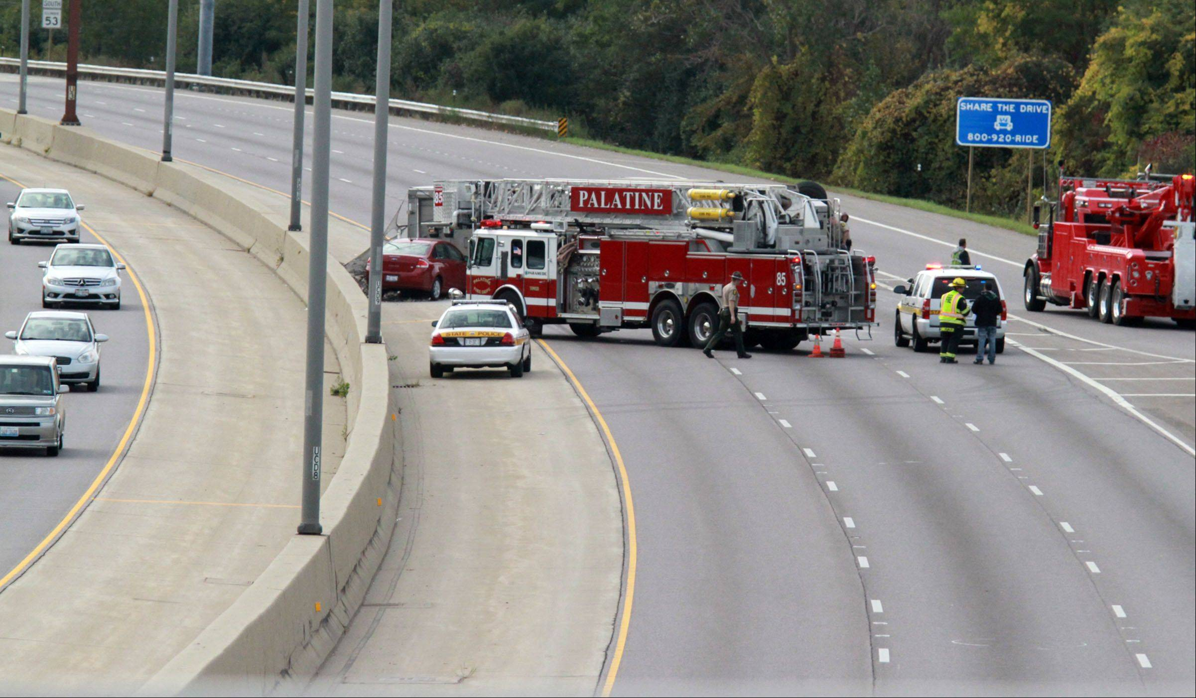A rolled over semi truck, blocked from view by a Palatine firetruck, caused authorities to close all southbound lanes on Route 53 just south of Euclid Avenue Tuesday morning.