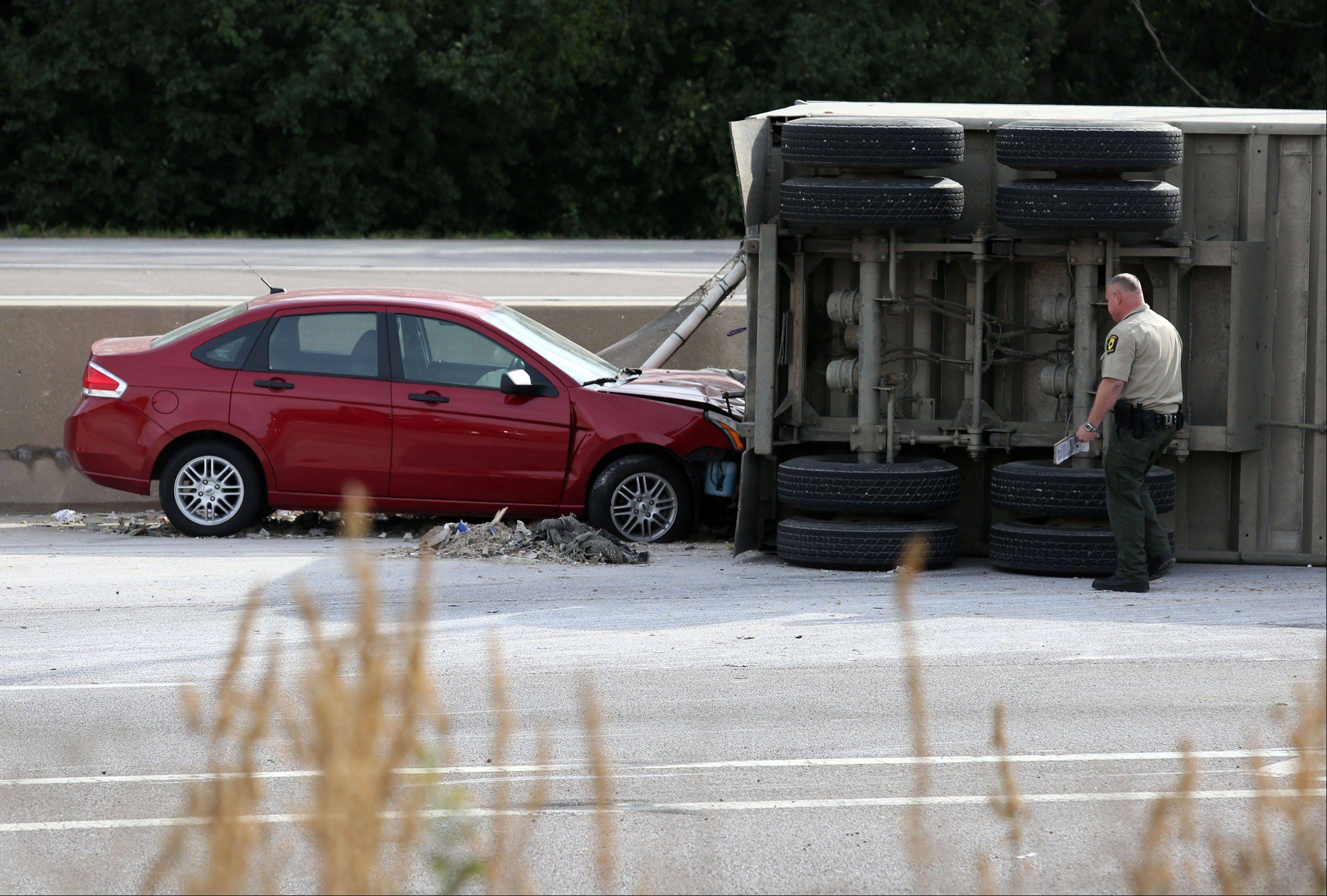 A car was involved in an accident when a semi truck rolled over on southbound Route 53 just south of Euclid Avenue on Tuesday morning. The crash caused long delays on Route 53.