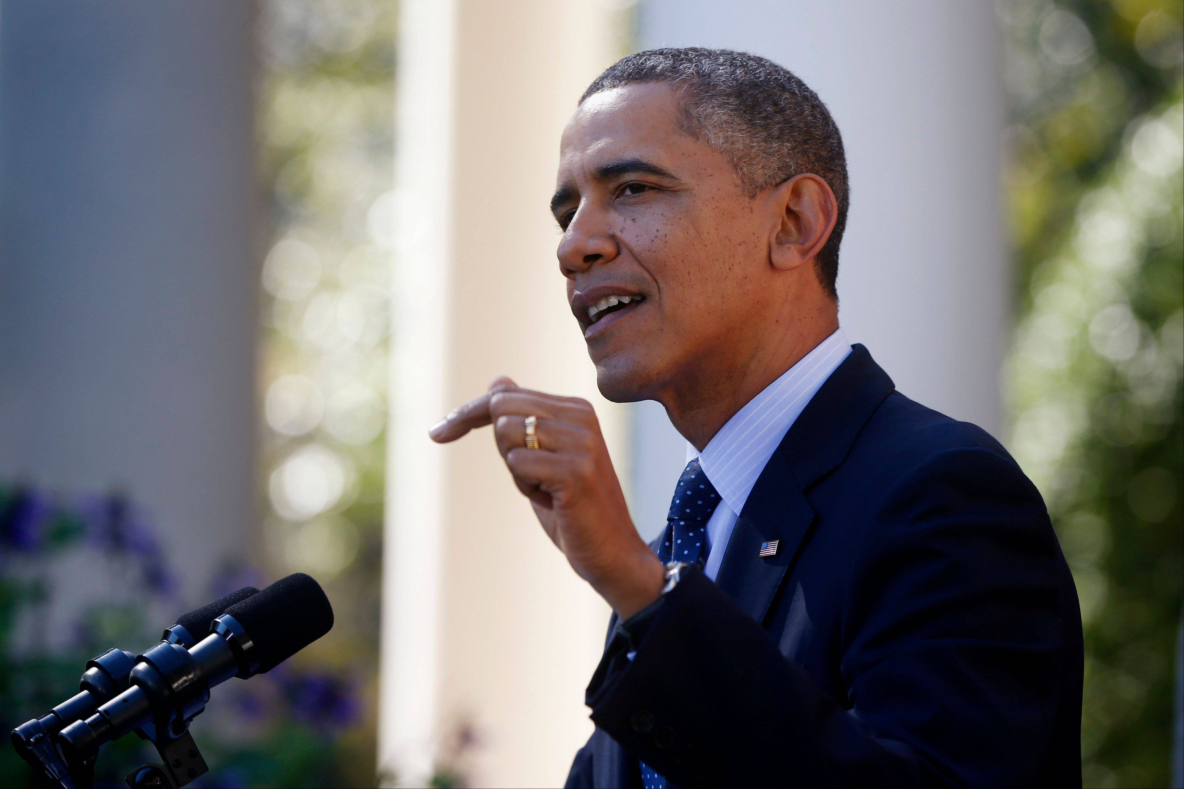 President Barack Obama gestures while speaking in the Rose Garden of the White House in Washington, Monday. Project developers who spoke to the AP on condition of anonymity -- because they feared they would otherwise be fired -- said they raised doubts among themselves whether the website could be ready in time.