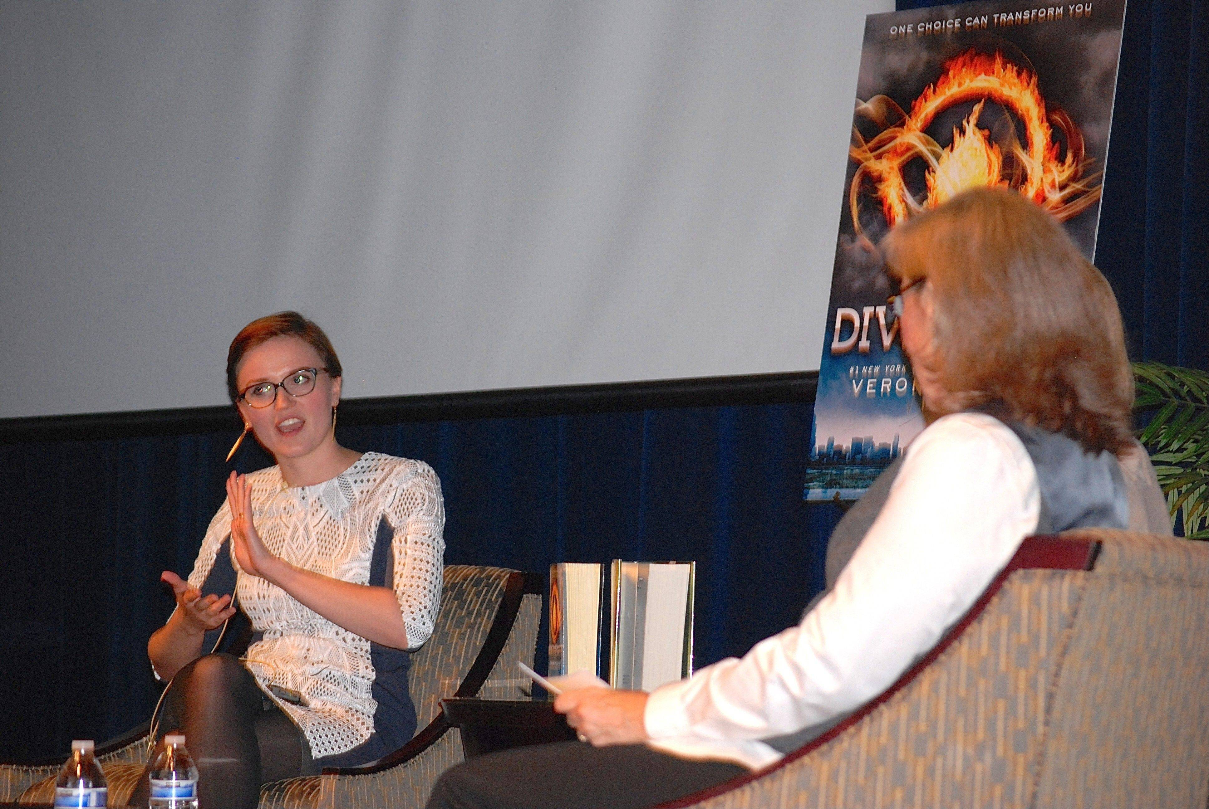 "During this month's appearance at Barrington High School, best-selling author and 2006 graduate Veronica Roth, left, discusses her ""Divergent"" trilogy of novels with English teacher June Kramer."