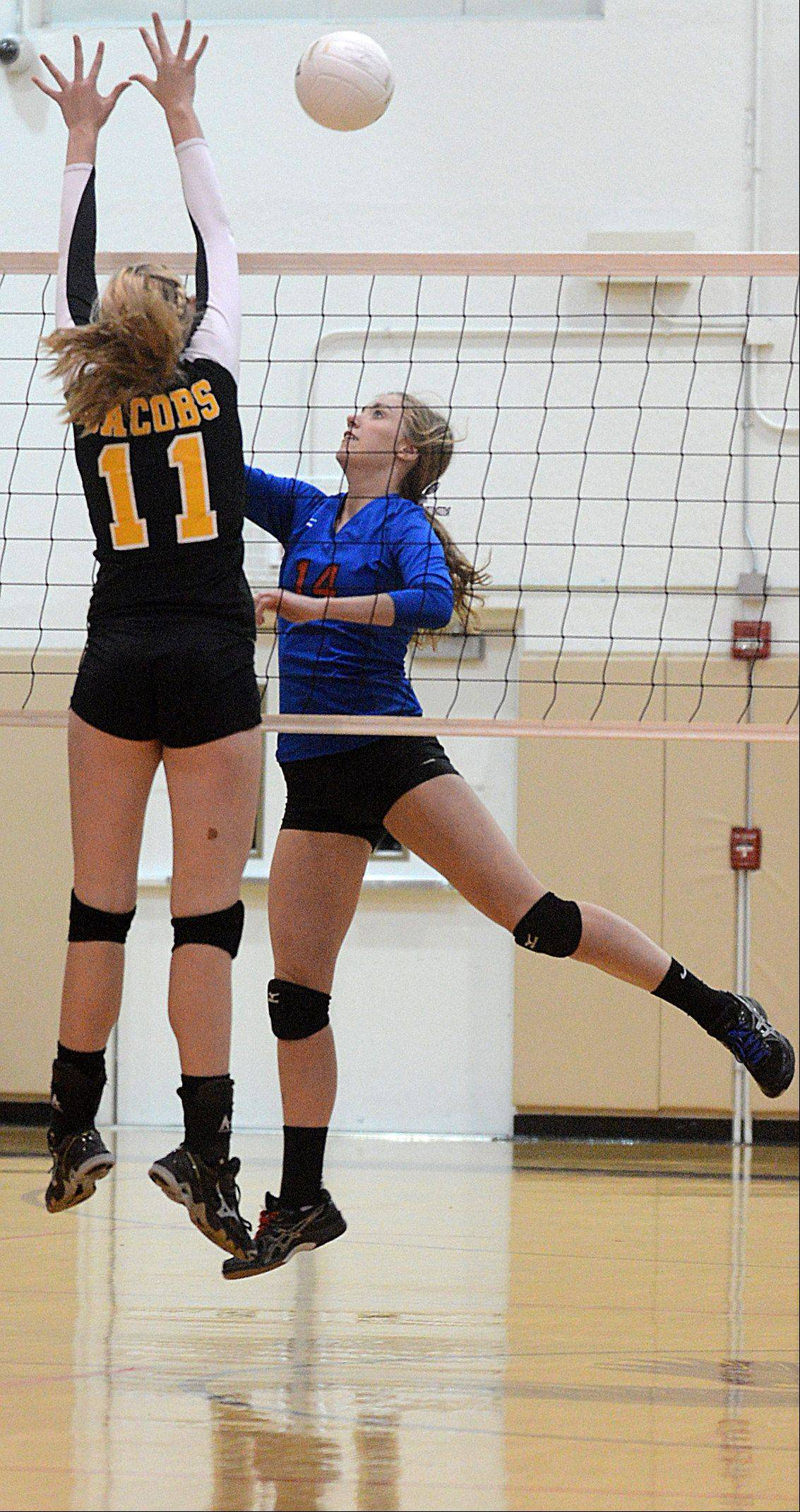 Dundee-Crown's Emily Michalsi, right, and Jacobs' Bridget Wallenberger, left, vie for control of the ball during a varsity volleyball game at Algonquin on Tuesday night.