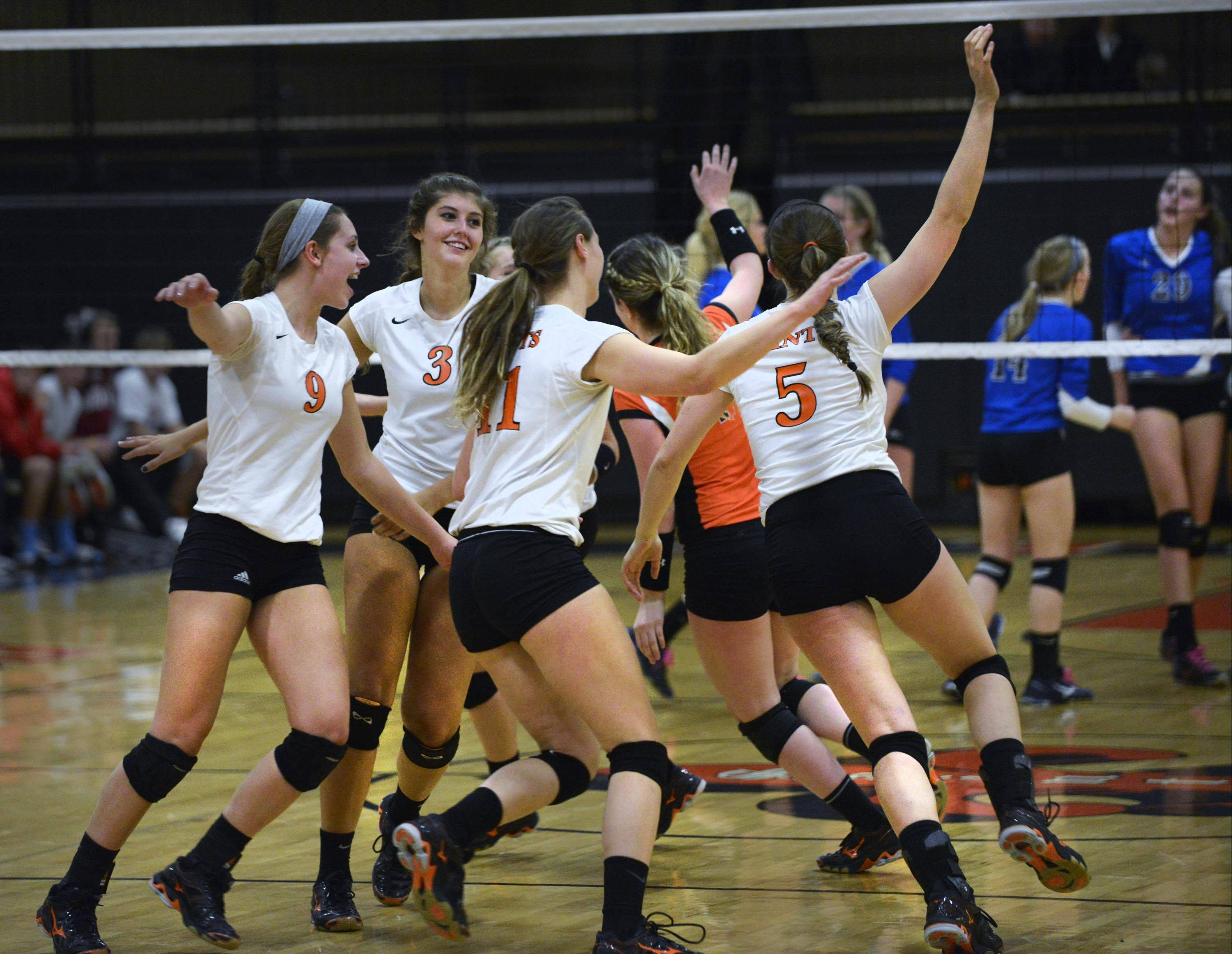 St. Charles East celebrates a late point Tuesday.