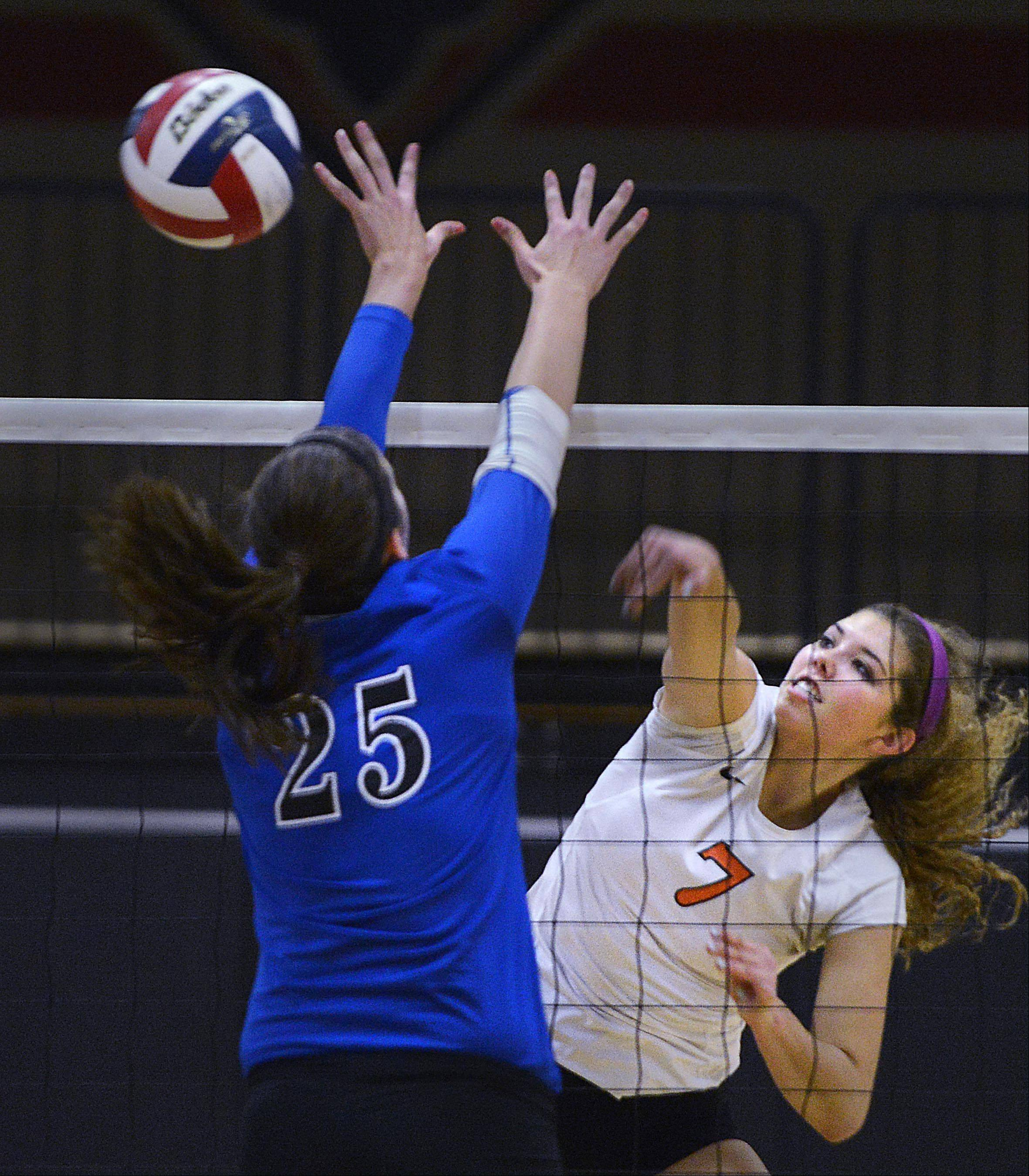 St. Charles East's Meagan Smith gets a shot past Geneva's Ally Barrett Tuesday in St. Charles.