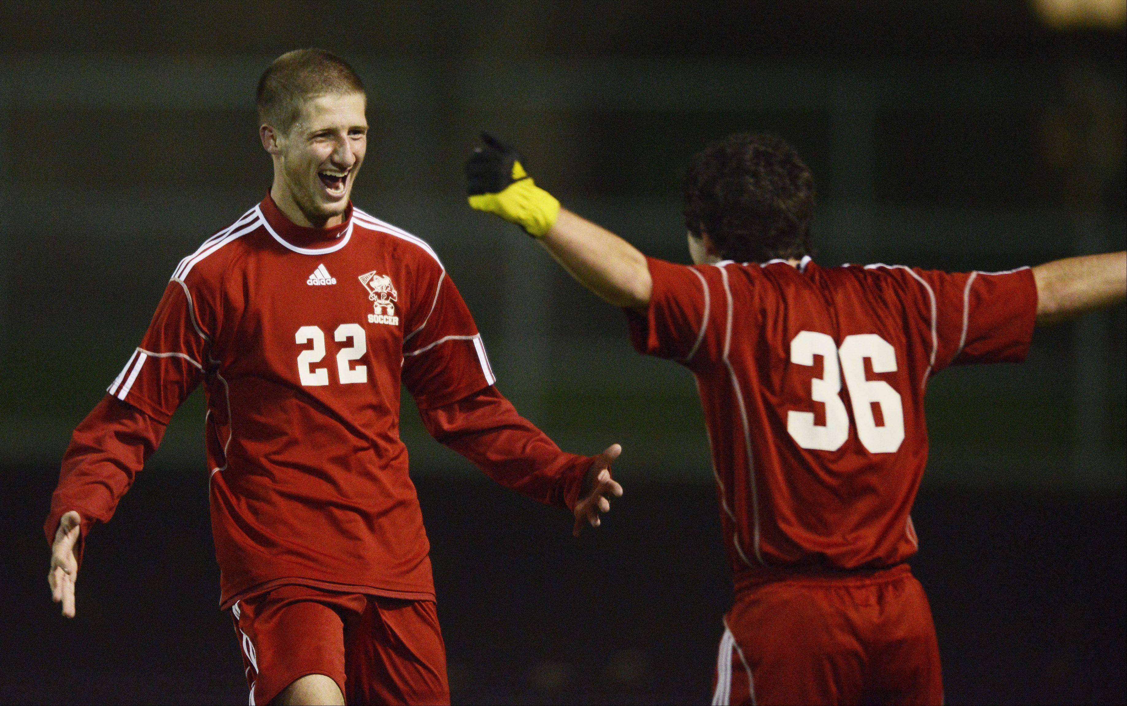 Palatine's Dan Cushing, left, and teammate Kyle Clancy celebrate a Pirates goal during the first half of Tuesday's game against Mundelein.