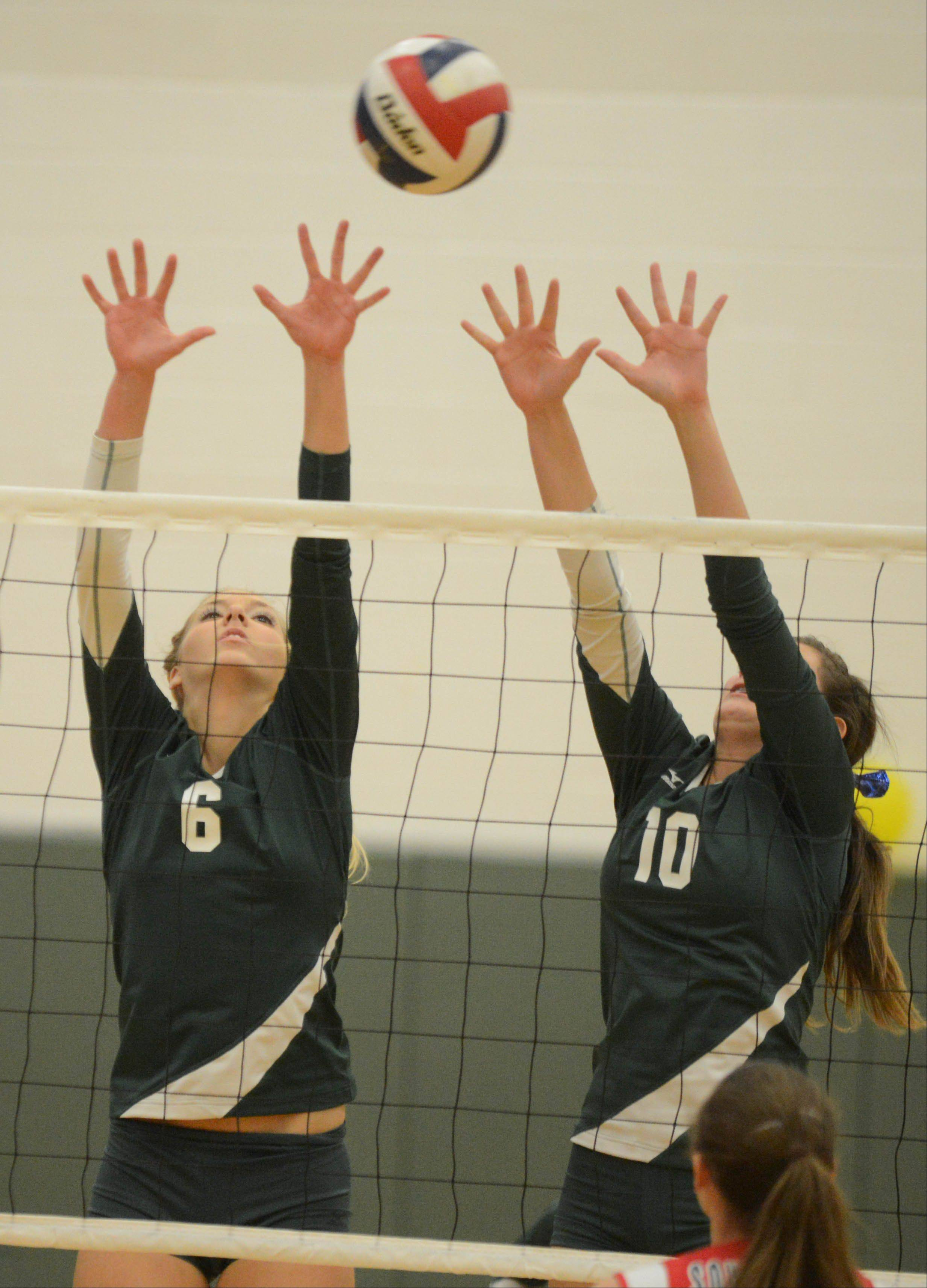 Waubonsie Valley's Rachel Minarick,left, and Katie Campbell took part in the Elgin vs. Waubonsie Valley girls volleyball game Tuesday.