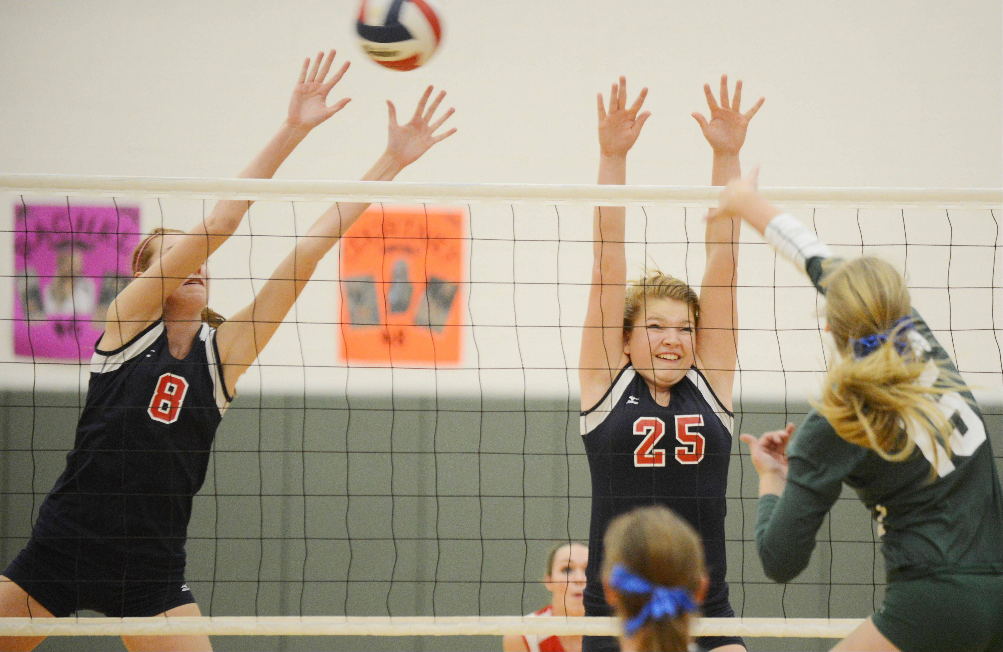 Sarah Halles,left, and Renee Rush both of South Elgin go up for the ball during the South Elgin at Waubonsie Valley girls volleyball game Wednesday.