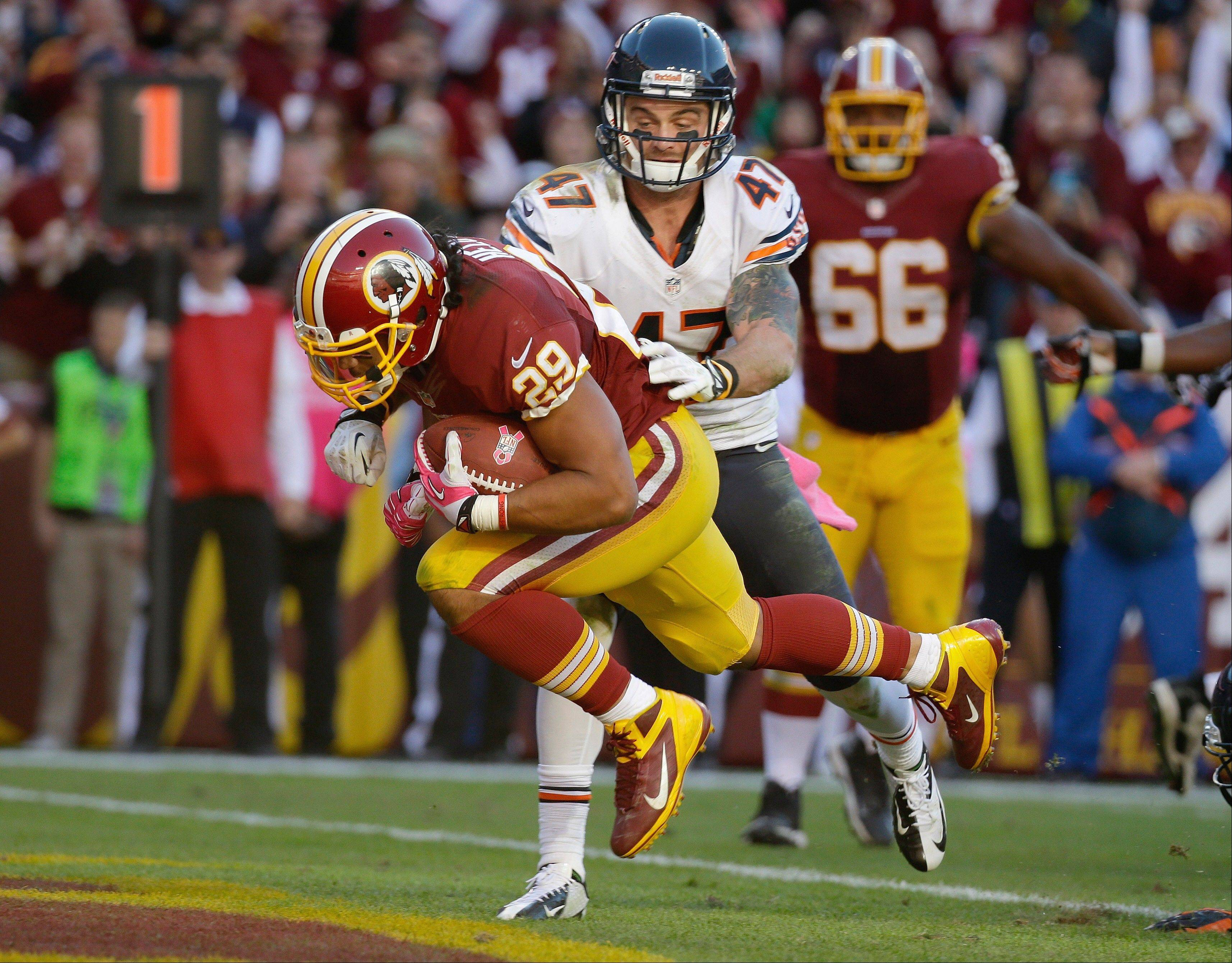 Washington running back Roy Helu Jr. carries the ball past Bears safety Chris Conte and into the end zone for the winning touchdown Sunday. For the first time in Bears history, opponents have scored at least 21 points through the first seven games.