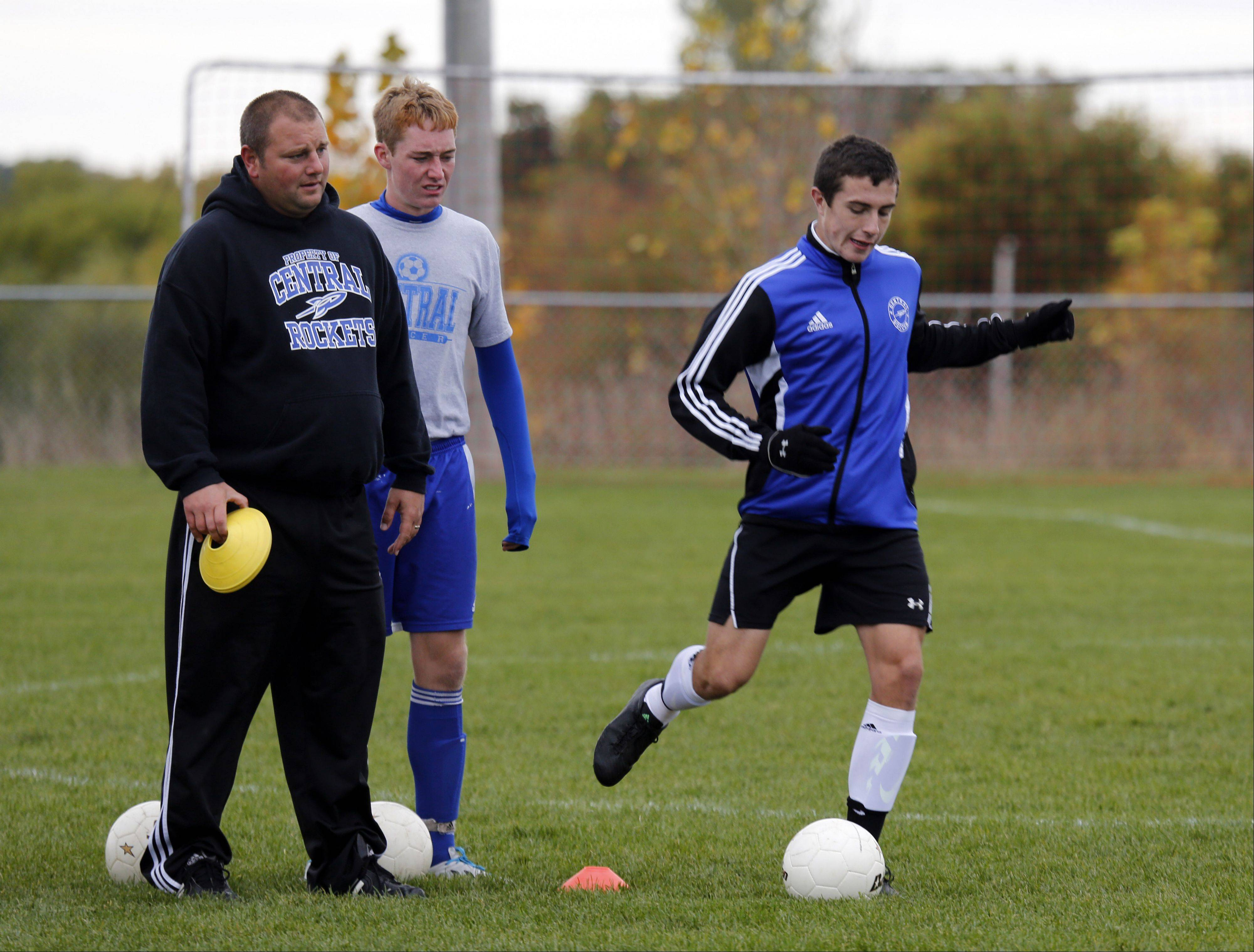 Burlington Central coach Mike Gecan, left, Sean Fitzgerald, and Matt O'Connor talk at a recent practice.