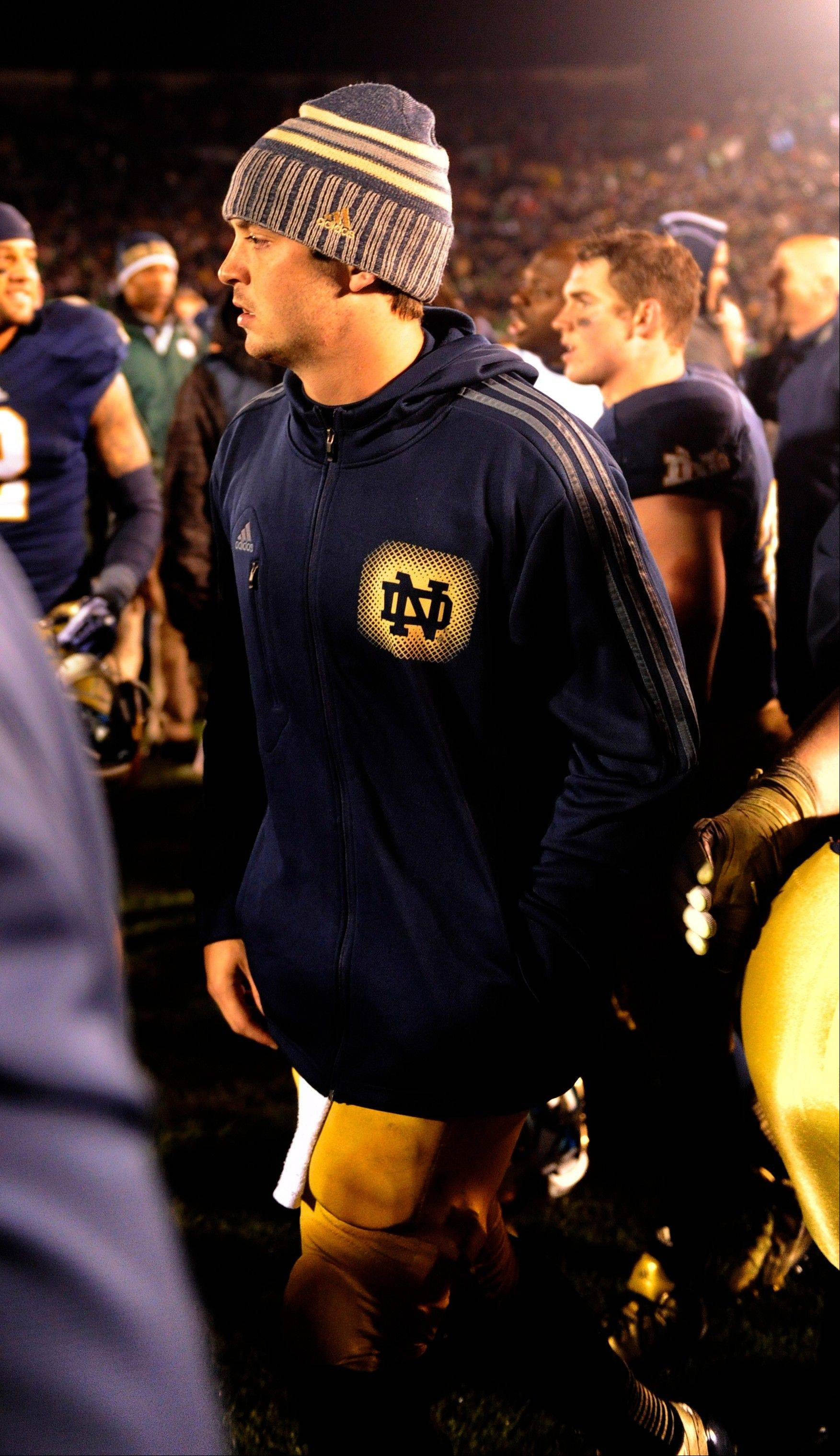 Notre Dame quarterback Tommy Rees walks off the field Saturday after Notre Dame's 14-10 victory over Southern California in South Bend. Rees was knocked out of the game in the third quarter.