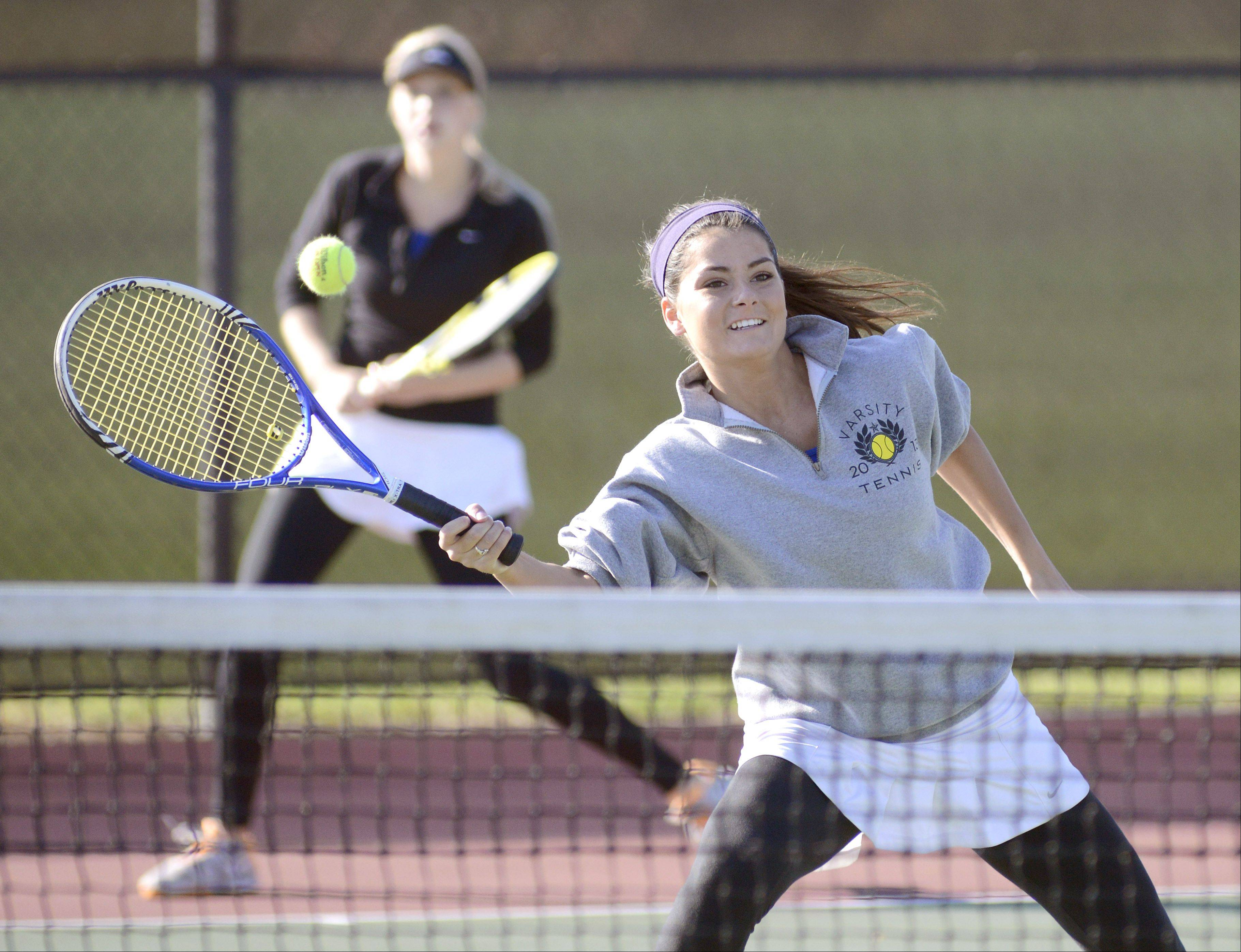 Geneva's Margo Hess plays against St. Charles East in Saturday's sectional tennis match. Hess and her doubles partner, Emma Hazel, qualified for state.