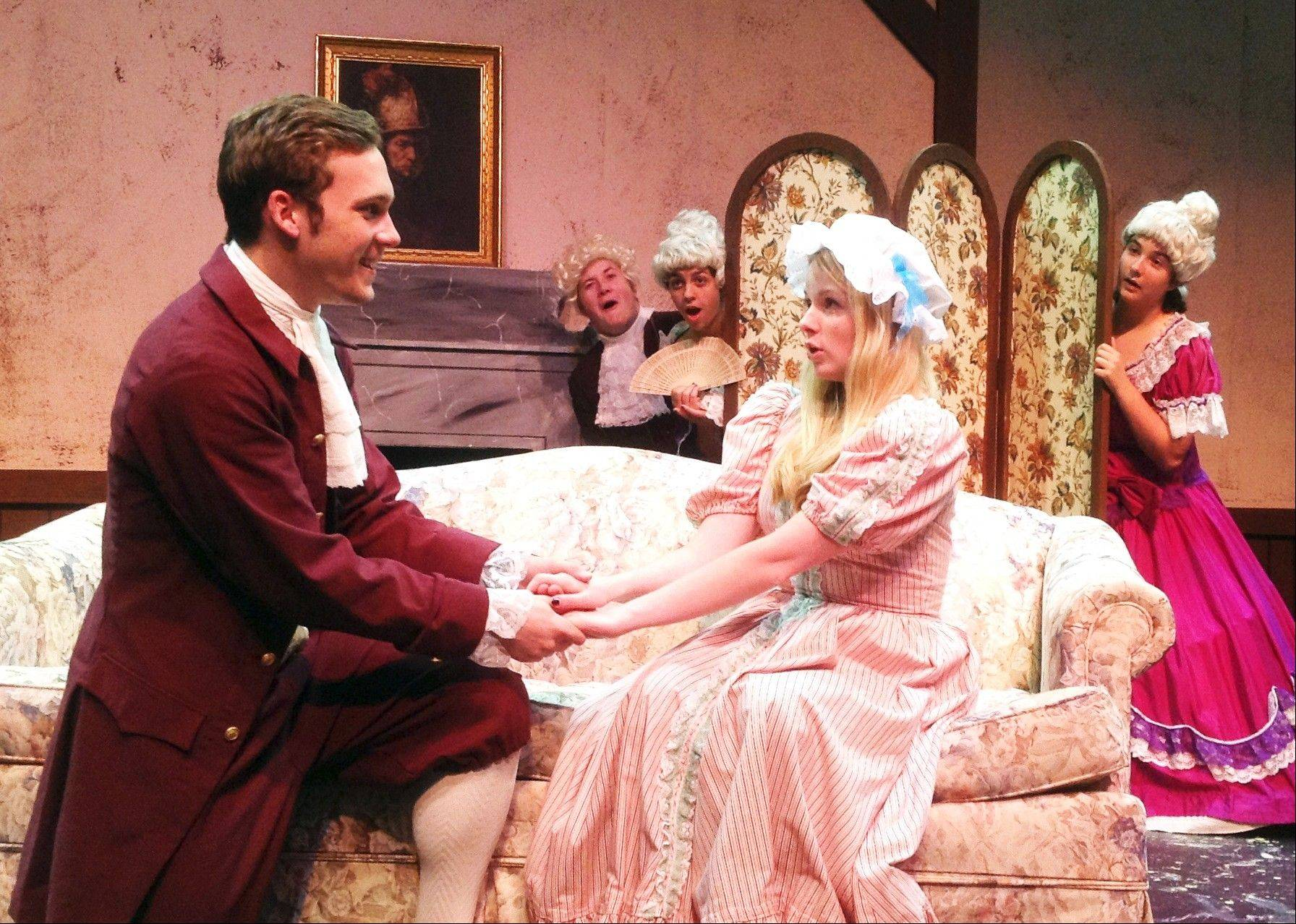 "Matt Beiswenger of Fox River Grove tries to woo the affections of Katie Del Ghingaro of Inverness in St. Viator's production of ""She Stoops to Conquer."""