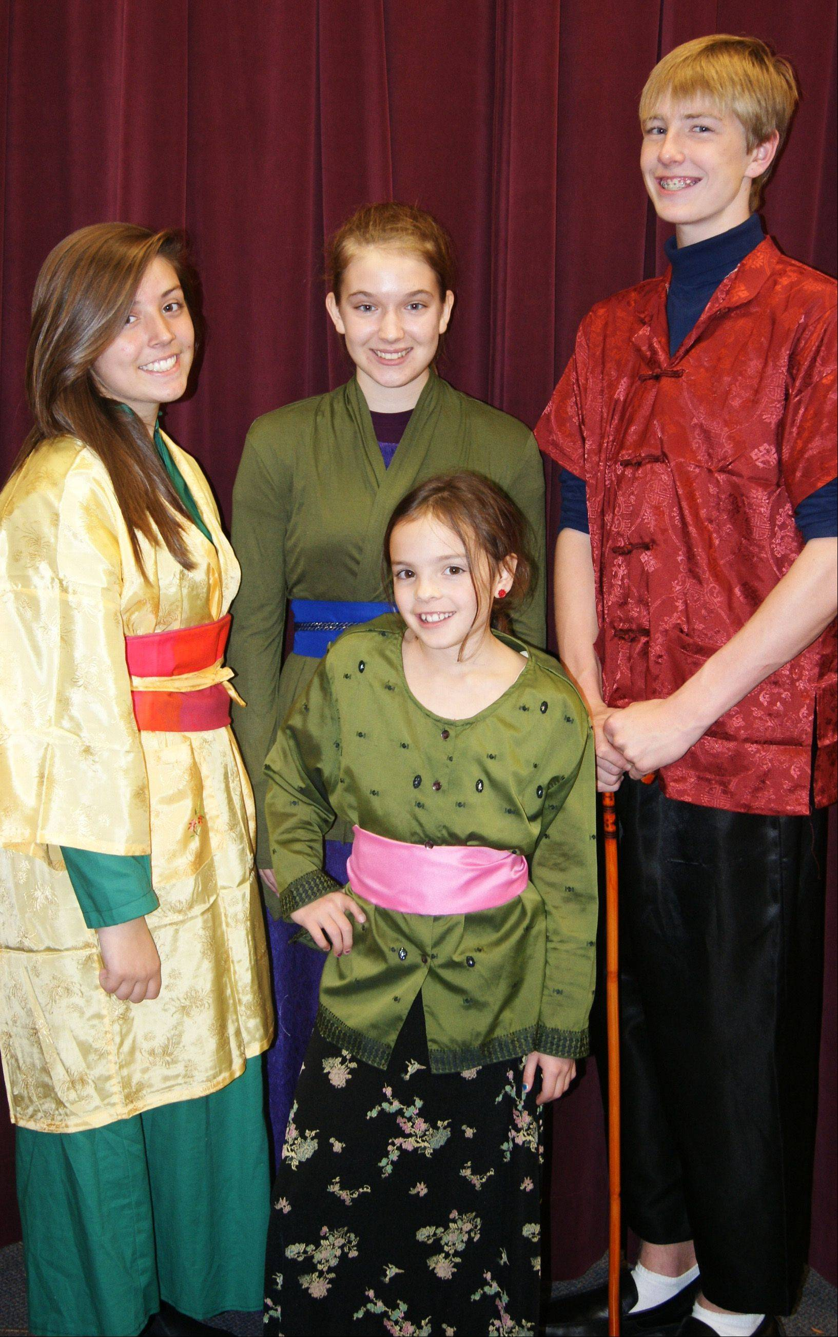 "The Fa family, is played by Haley Dulabaum, from left, Emilie Knieriemen, Elizabeth McKay and Braedon Harder in the Children's Theatre of Elgin production of ""Mulan Jr."""