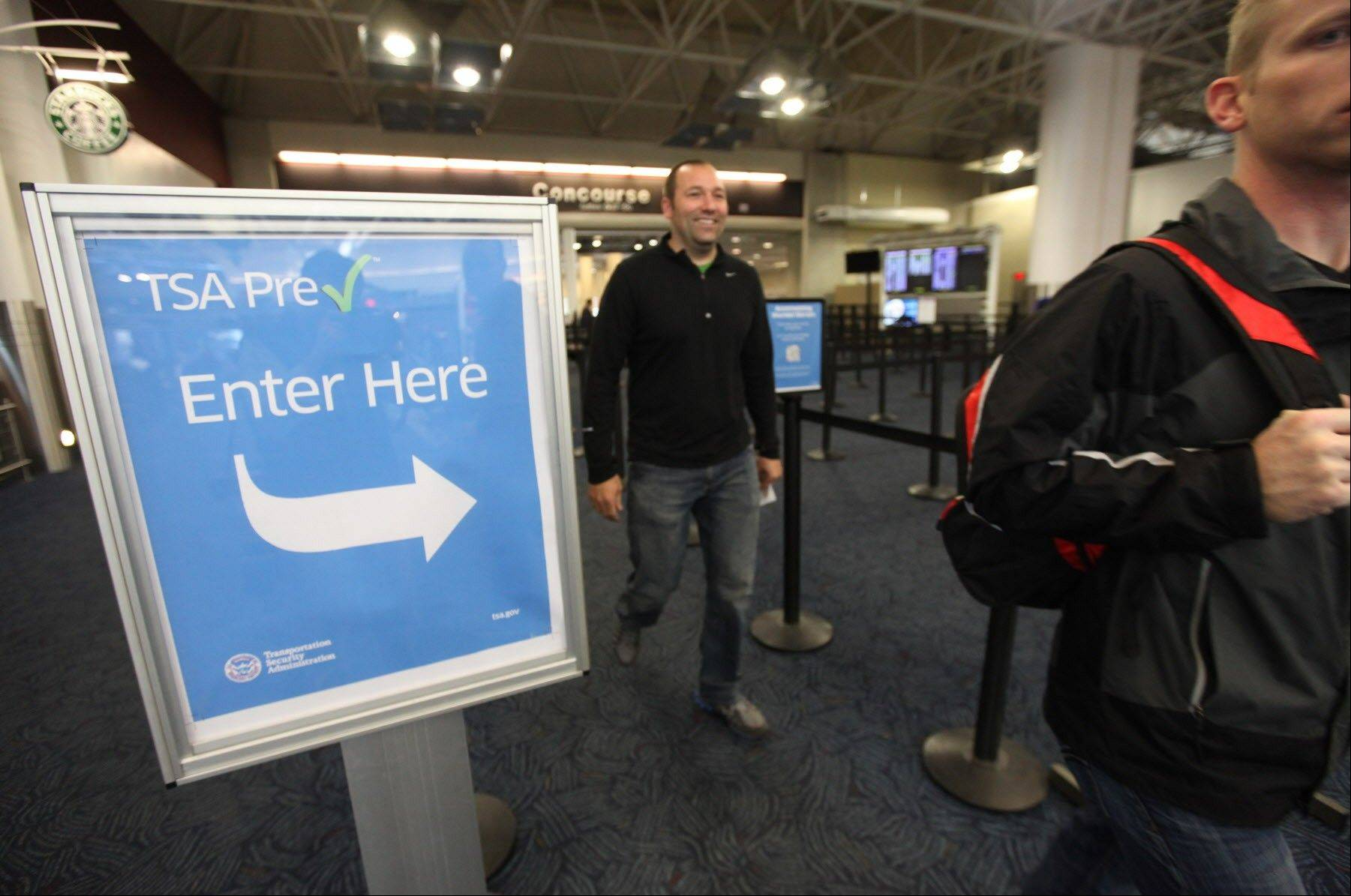 Passengers walk through the pre-check lane at Milwaukee�s Mitchell International Airport Tuesday.