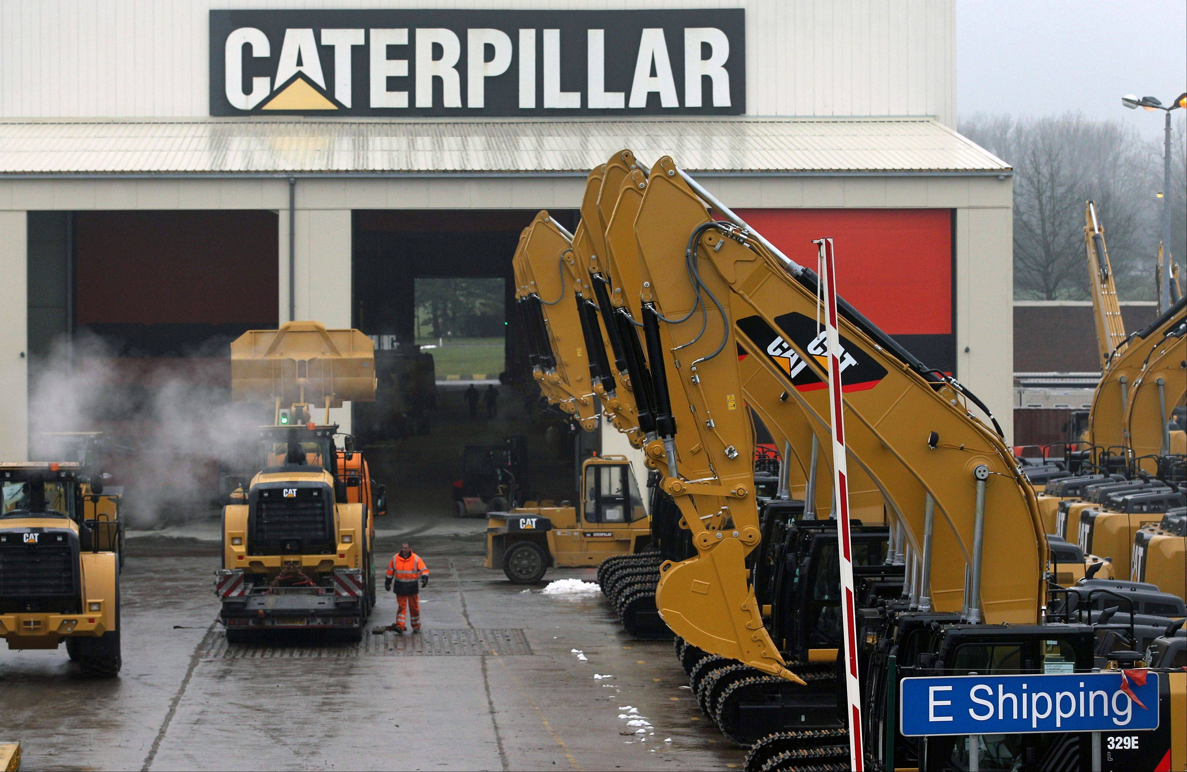 Peoria-based Caterpillar says its third-quarter earnings plunged 44 percent, and the construction equipment maker cut its 2013 forecast again, partly because of weaker mining equipment sales.