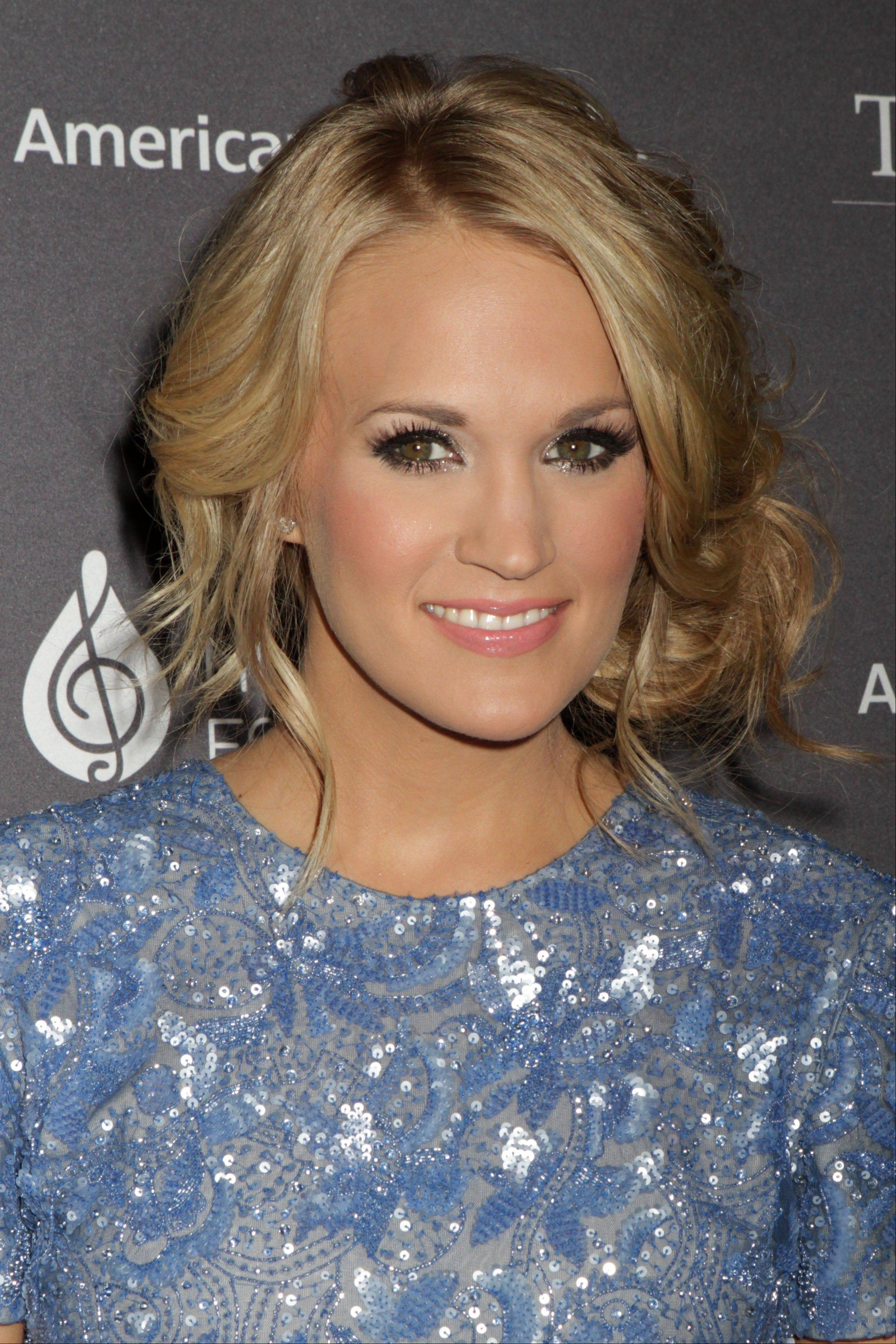 "Carrie Underwood attends the T.J. Martell Foundation 38th Honors Gala on Tuesday in New York. With her hosting duties at the Country Music Association Awards and starring in a live television version of ""The Sound of Music,"" Underwood has a lot to look forward to in the next few months."