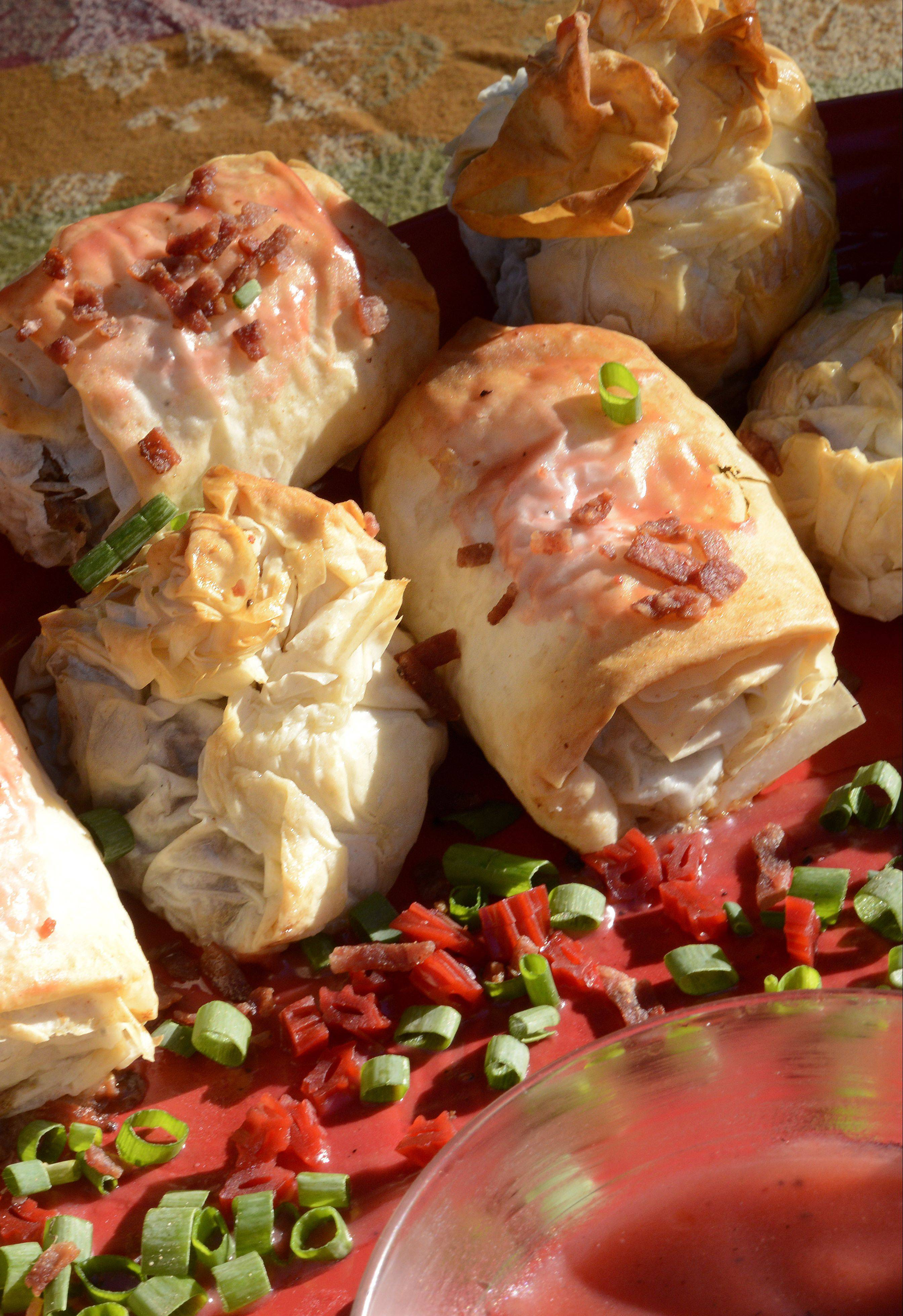 Dan Rich�s appetizer spread included Phyllo Bombs and beef Wellingtons both served with a Twizzler port sauce.
