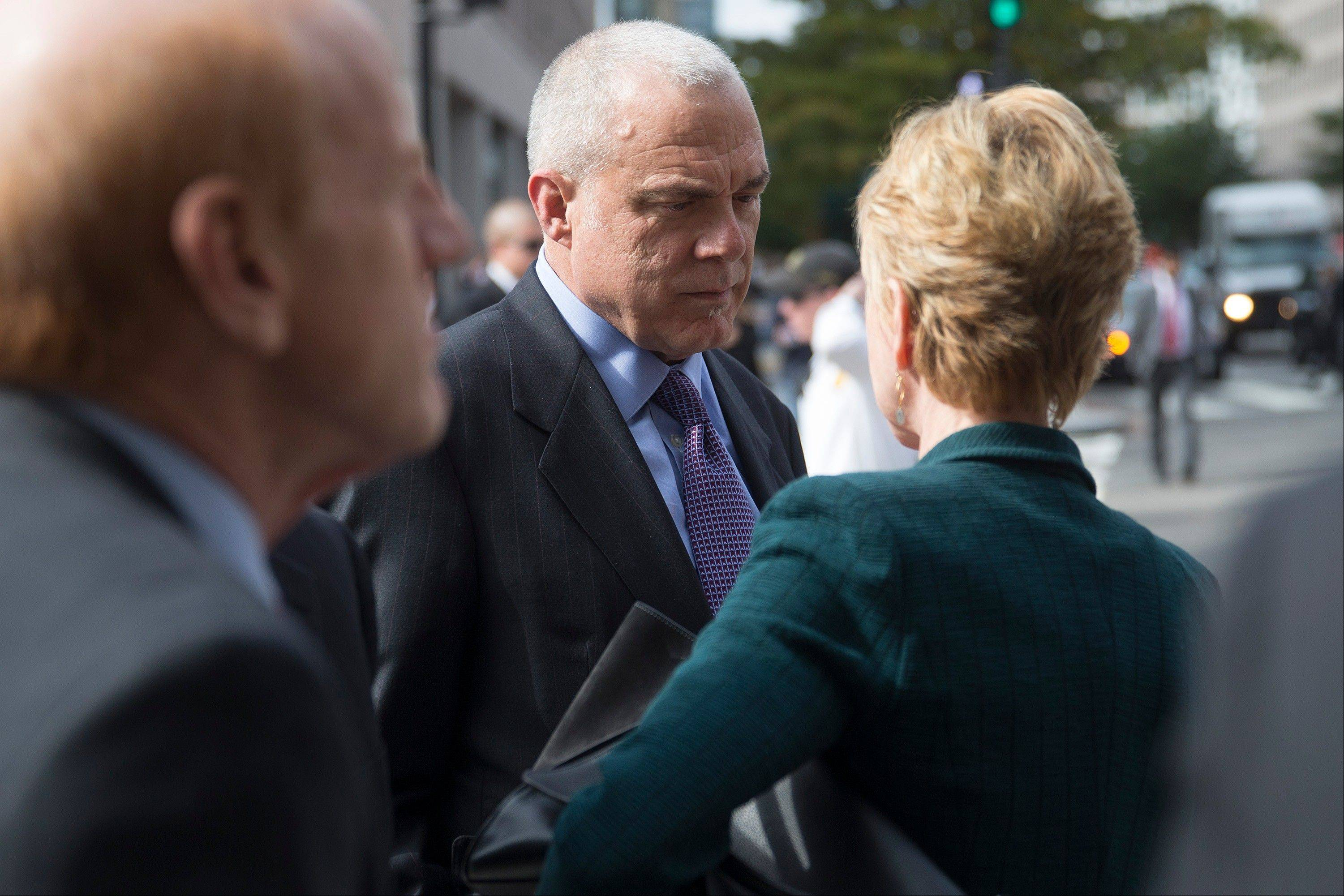Mark Bertolini, chairman, president and chief executive officer of Aetna Inc., center, talks Wednesday to Karen Ignagni, president and chief executive officer of America's Health Insurance Plans (AHIP), before entering the White House.