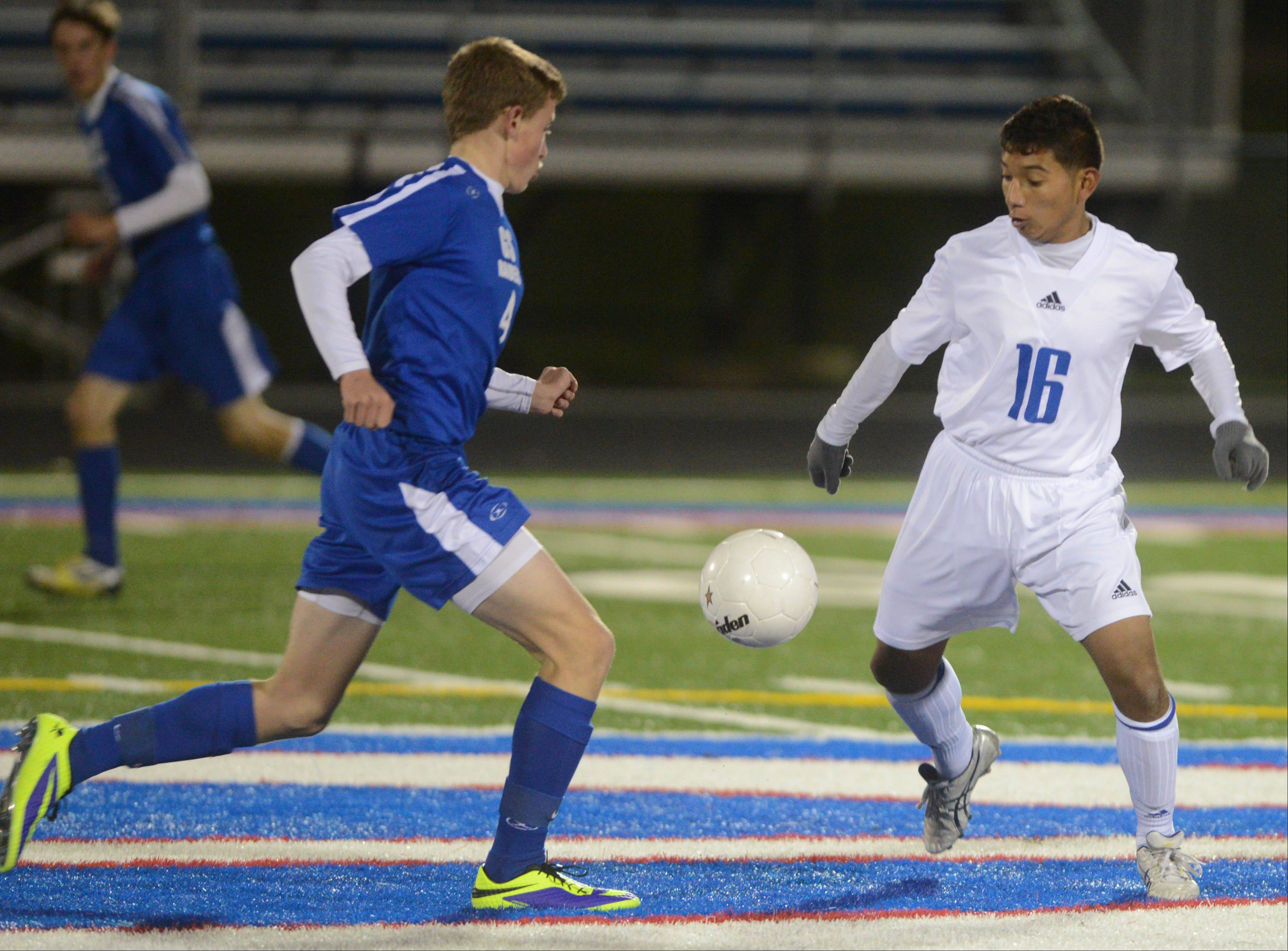 Chris Enright,left, of Glenbad South and Kevin Cortes of Fenton vie for the ball during the Fenton at Glenbard South boys soccer Class 2A regional semifinal game.