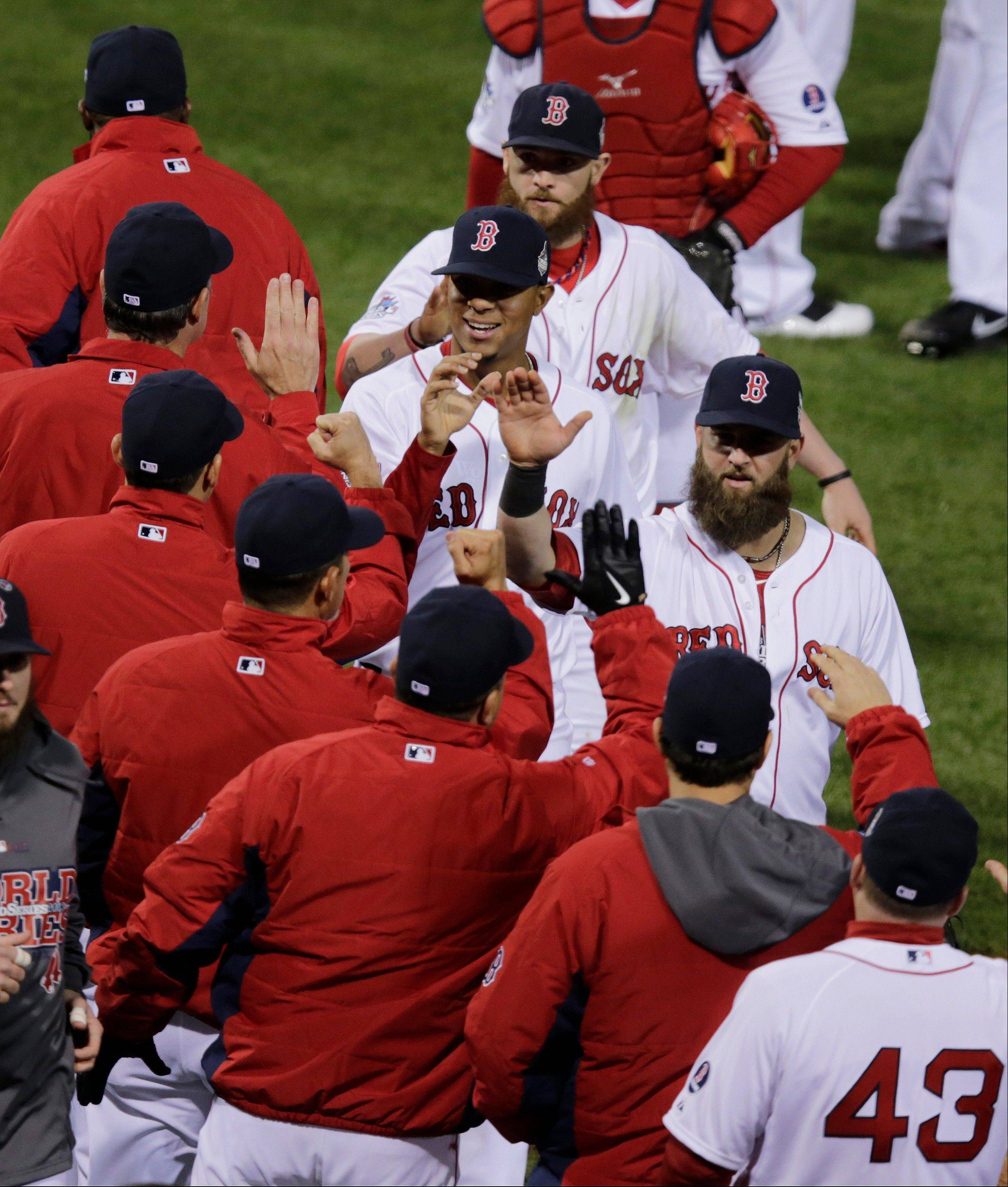 Boston players celebrate after Game 1 of the World Series against the St. Louis Cardinals. The Red Sox won 8-1 Wednesday night at home.