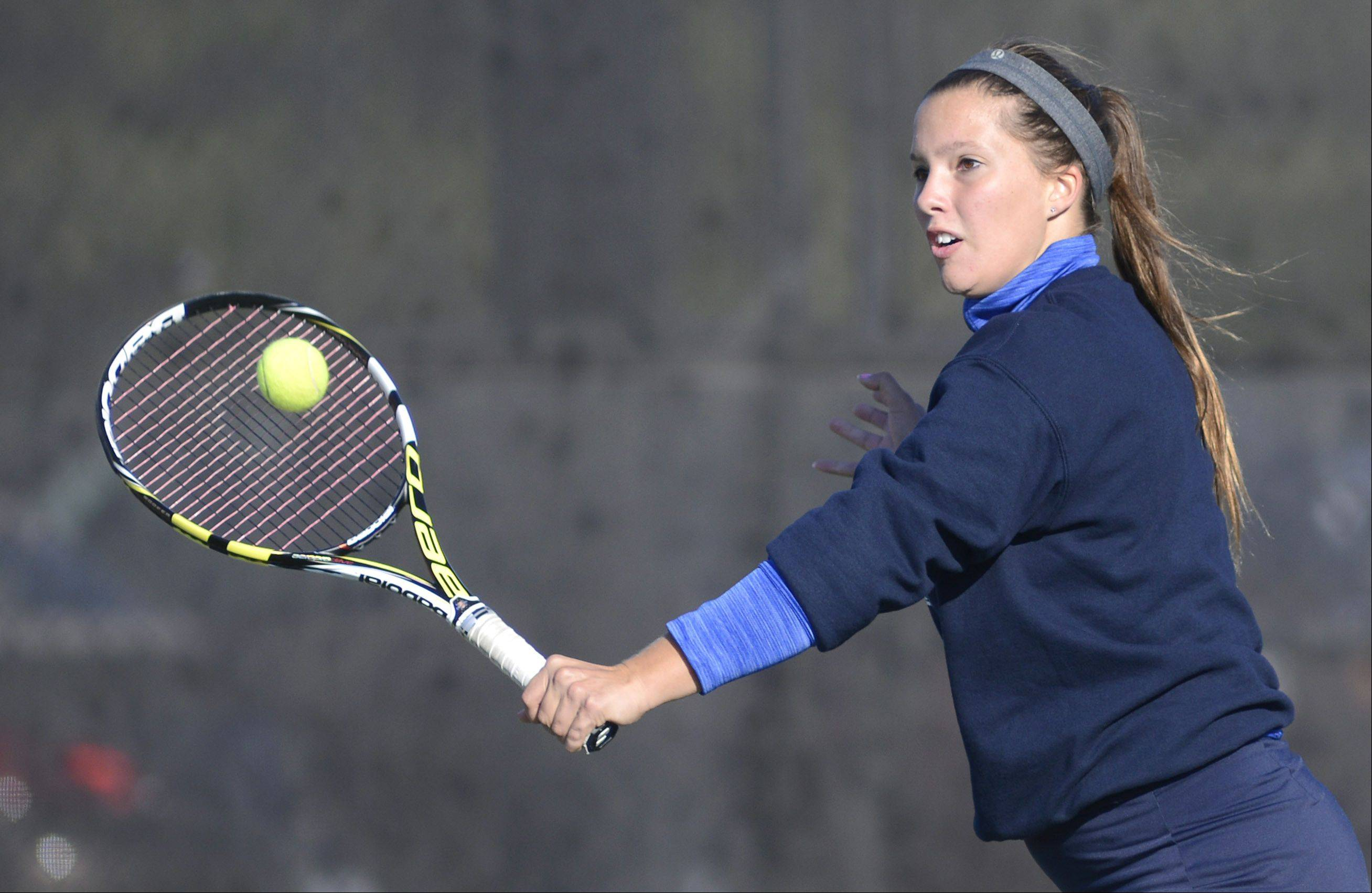 Bartlett senior Jen Gates returns a serve during the doubles championship match vs. Batavia last weekend at St. Charles East. Gates will team with senior Gabby Gregorio at the IHSA state tournament beginning Thursday morning at Prospect.