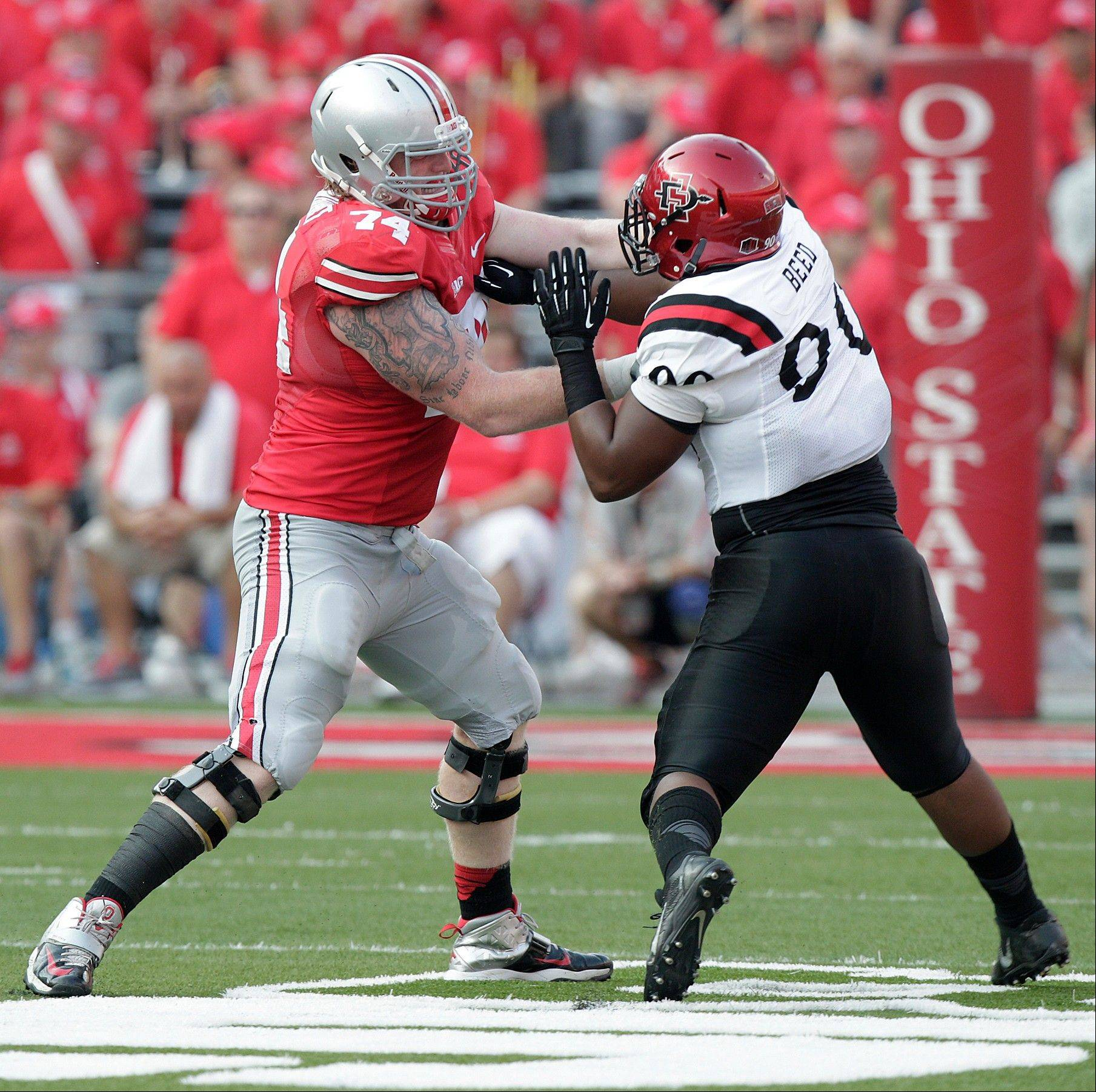 Ohio State offensive lineman Jack Mewhort blocks against San Diego State during the Sept. 7 game in Columbus, Ohio. Players on the Buckeyes� offensive line average 6-foot-6 and 310 pounds.
