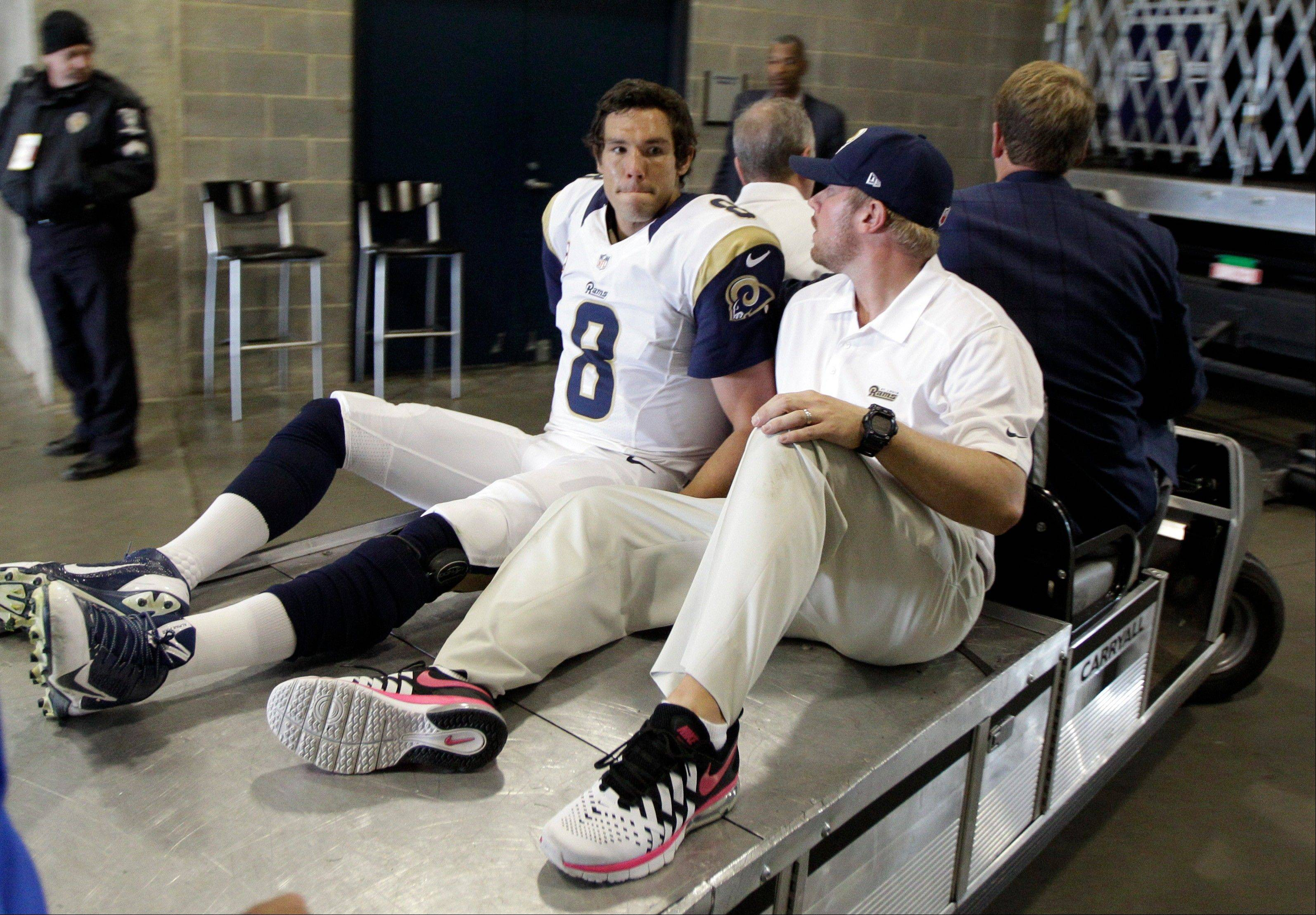 St. Louis quarterback Sam Bradford will miss the rest of the season because of a torn knee ligament suffered in Sunday's road game against the Carolina Panthers.