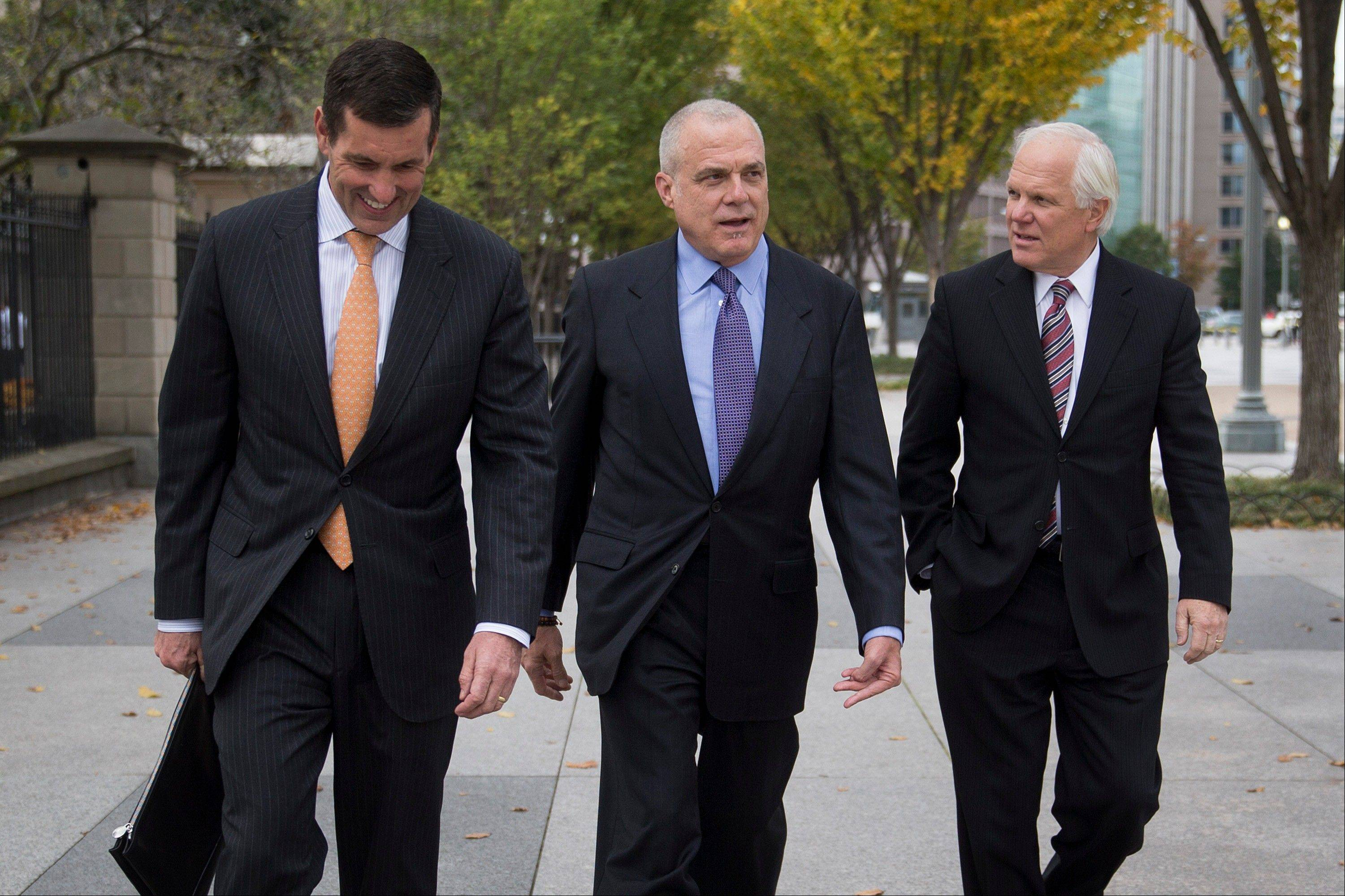 "Bruce Broussard, chief executive officer of Humana Inc., from left, Mark Bertolini, chairman, president and chief executive officer of Aetna Inc., and Joseph ""Joe"" Swedish, chief executive officer of Wellpoint Inc., walk Wednesday toward the White House. Health insurance executives met with top White House officials over the troubled online enrollment program."