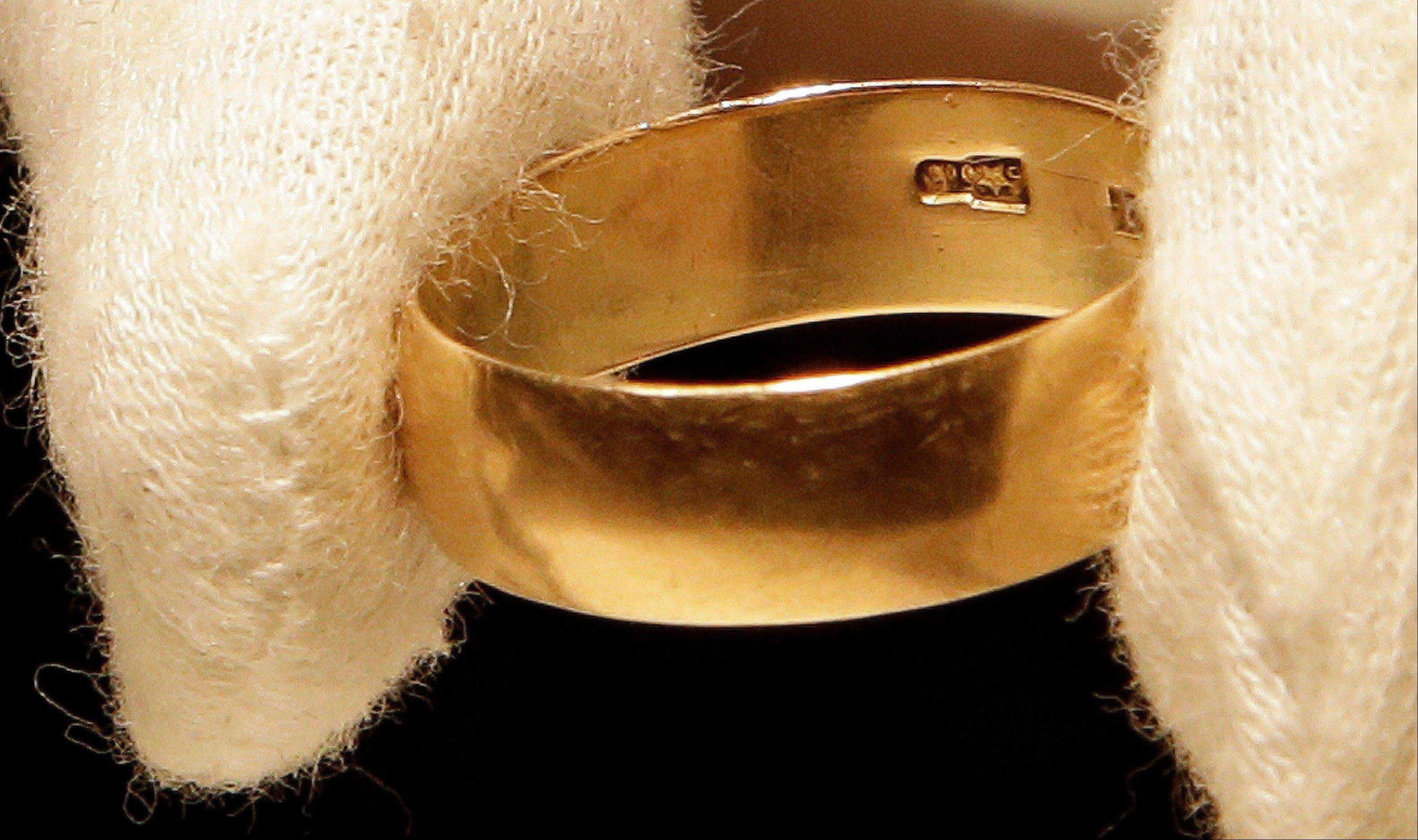 "Lee Harvey Oswald's wedding ring, which he left at his wife's, Marina Oswald, bedside the morning of the assassination of President John Fitzgerald Kennedy, is part of a themed JFK memorabilia auction ""Camelot: Fifty Years After Dallas"" at the Omni Parker House hotel in Boston."