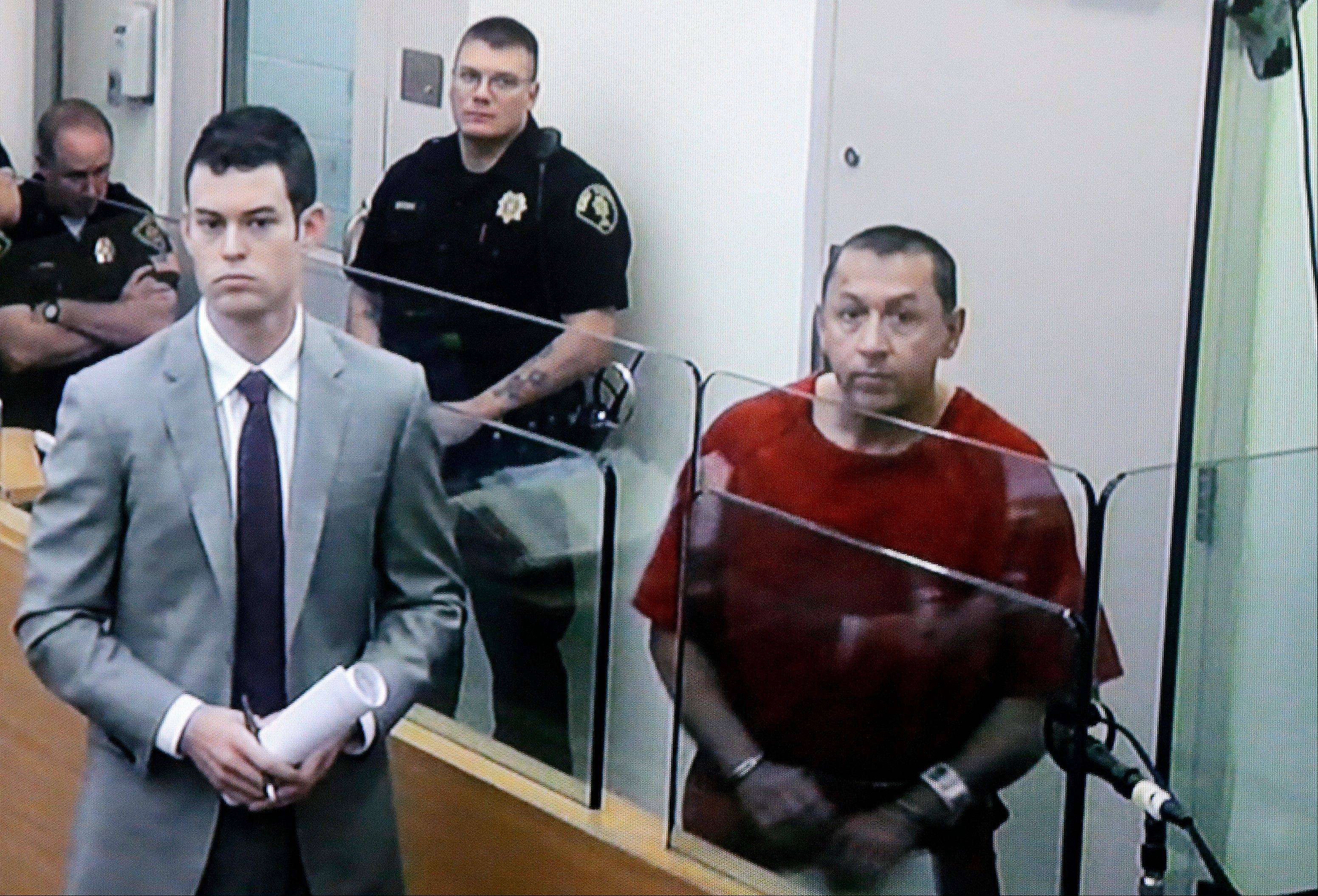 Michael Sean Stanley, right, appears in court Wednesday with defense attorney Nick Gross.