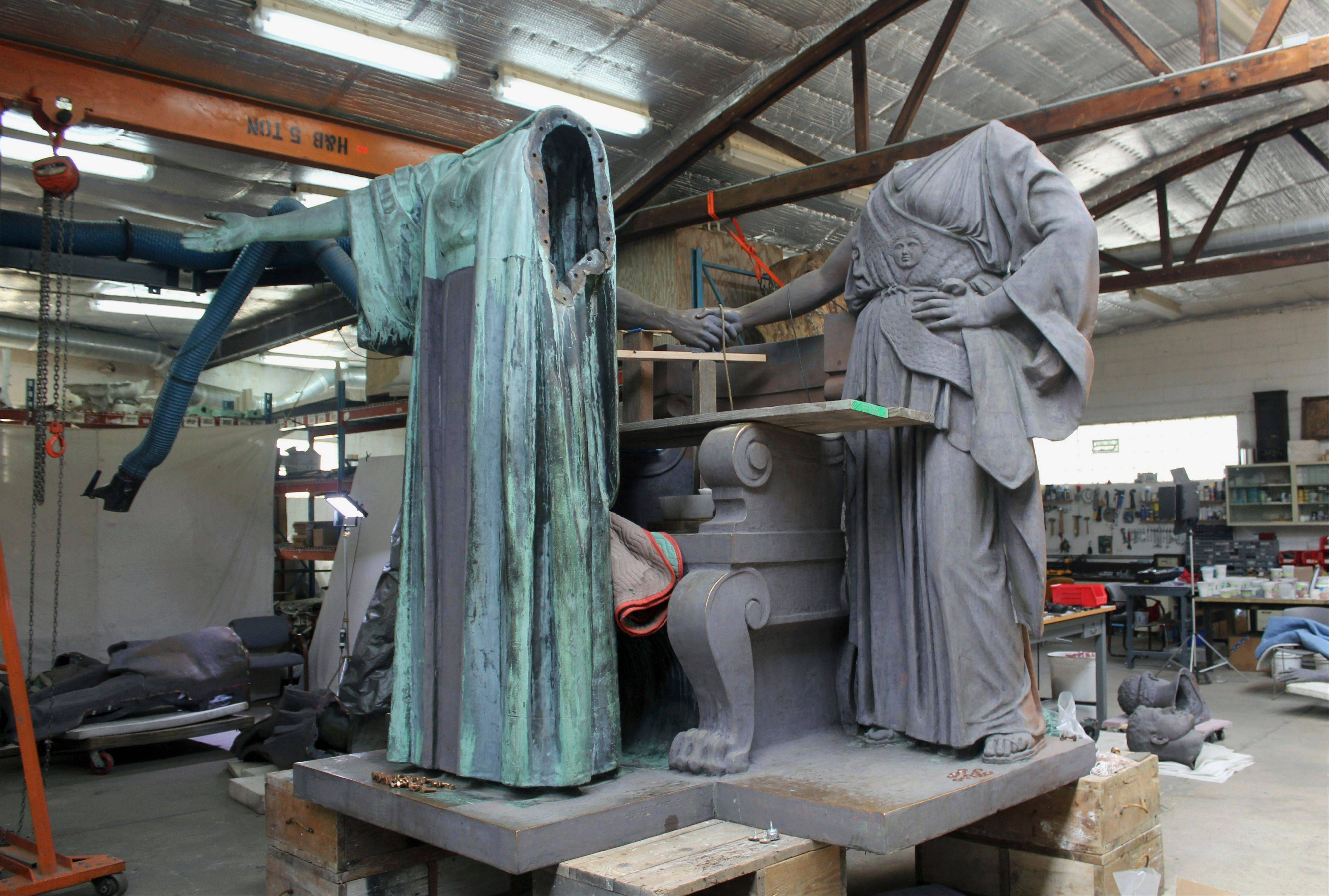 The famous statue Alma Mater sits partly disassembled at a studio in Forest Park as it undergoes repair and restoration.